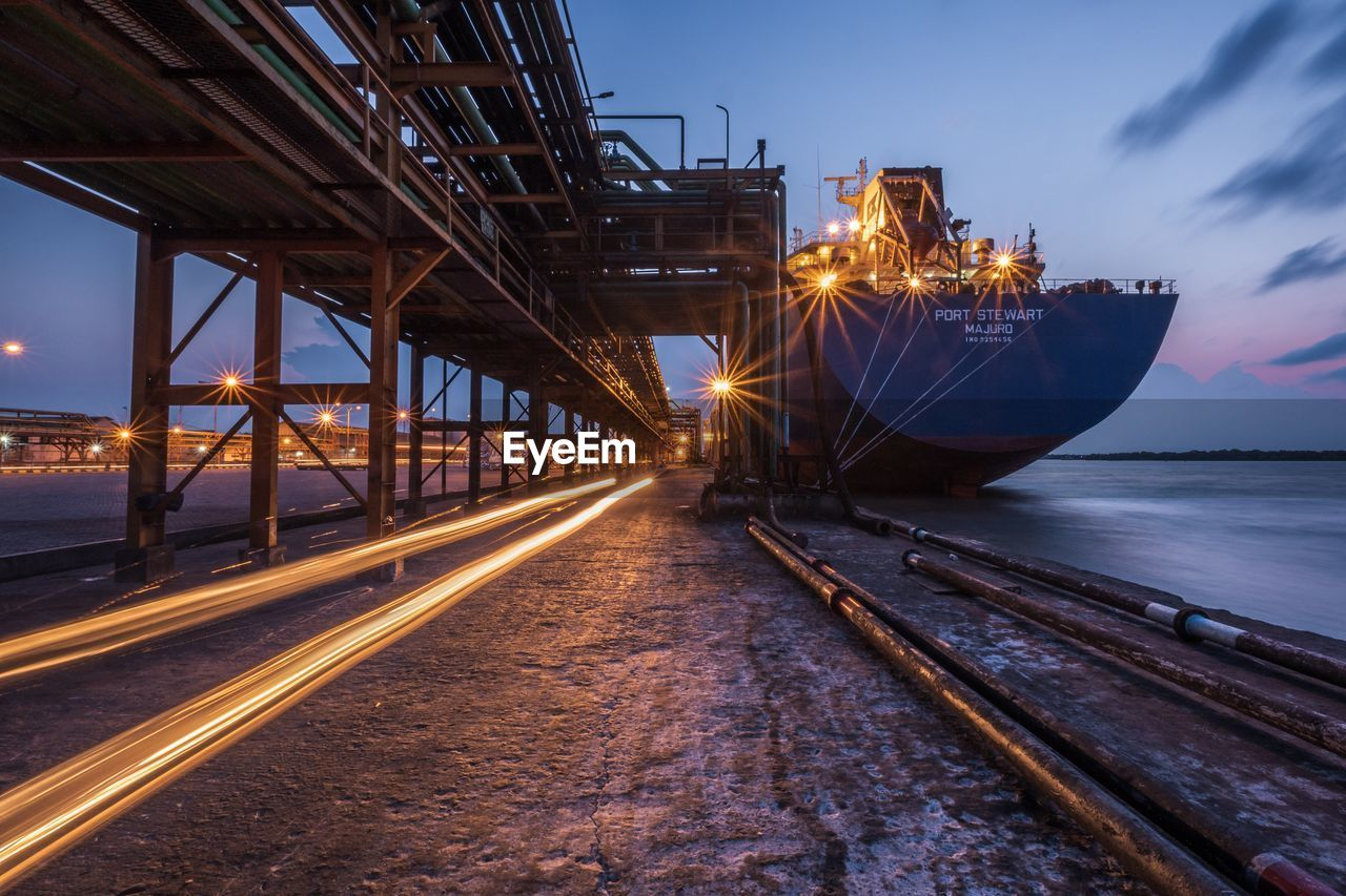 transportation, sky, mode of transportation, water, sea, motion, nautical vessel, sunset, illuminated, nature, no people, architecture, outdoors, ship, built structure, long exposure, travel, blurred motion, connection