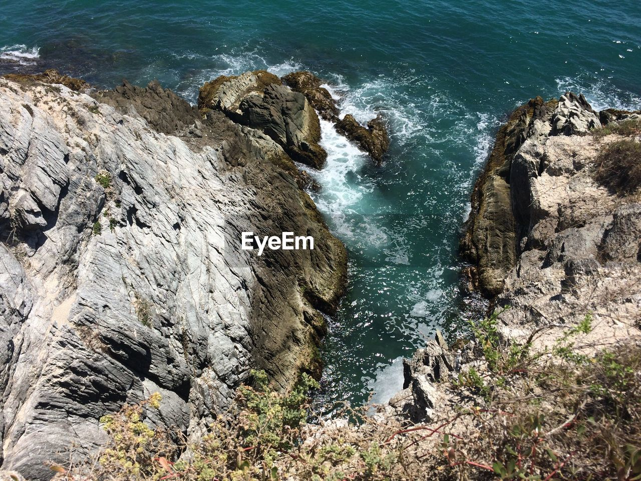 rock - object, water, sea, rock formation, nature, high angle view, beauty in nature, no people, day, scenics, cliff, outdoors, motion, wave