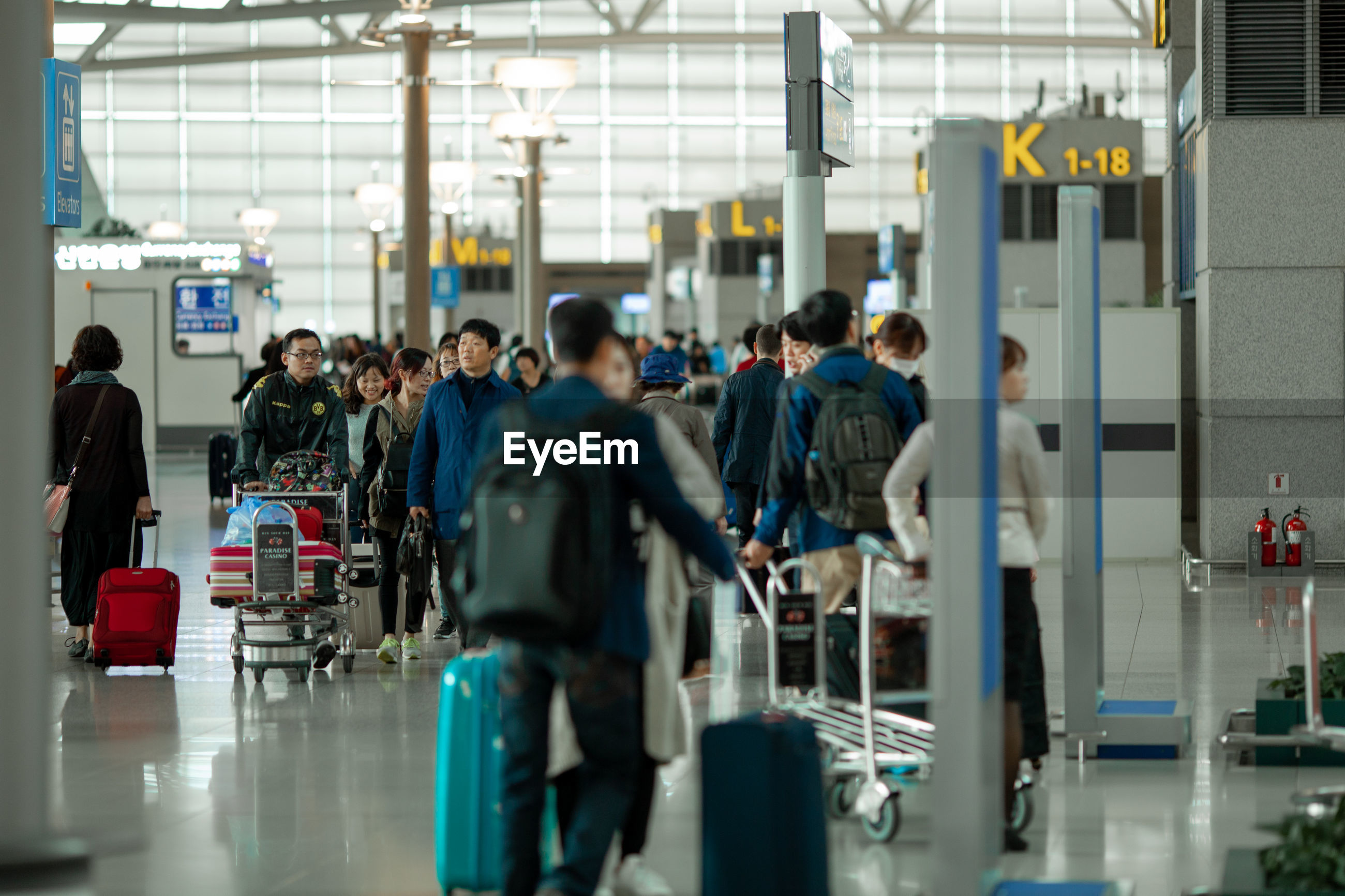 GROUP OF PEOPLE ON AIRPORT
