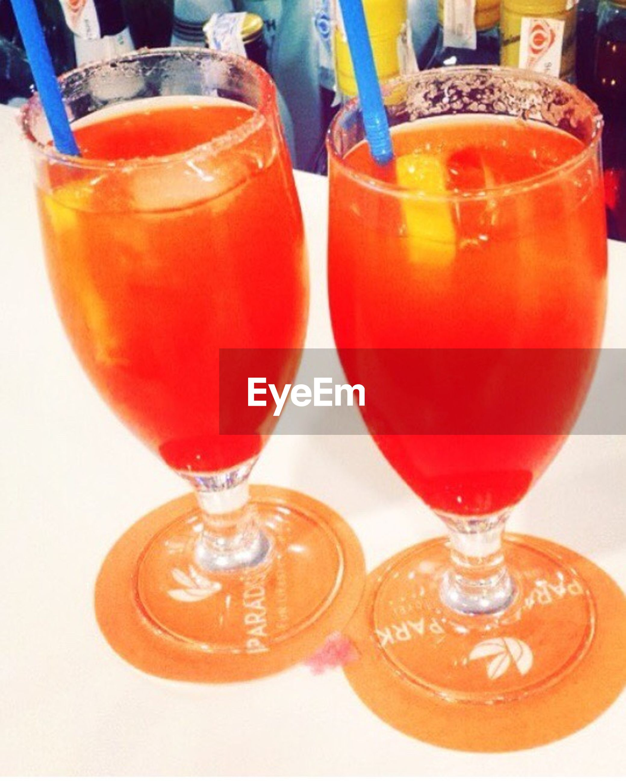 drink, drinking glass, refreshment, food and drink, cocktail, orange color, red, alcohol, close-up, no people, orange juice, drinking straw, freshness, healthy eating, indoors, food, day, liqueur, blood orange