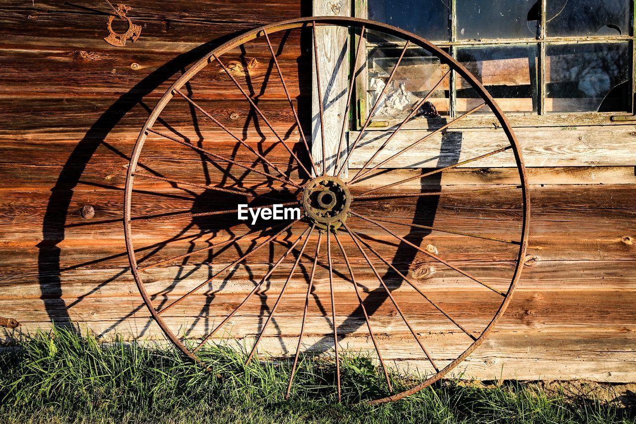 Old Wheel Outside House