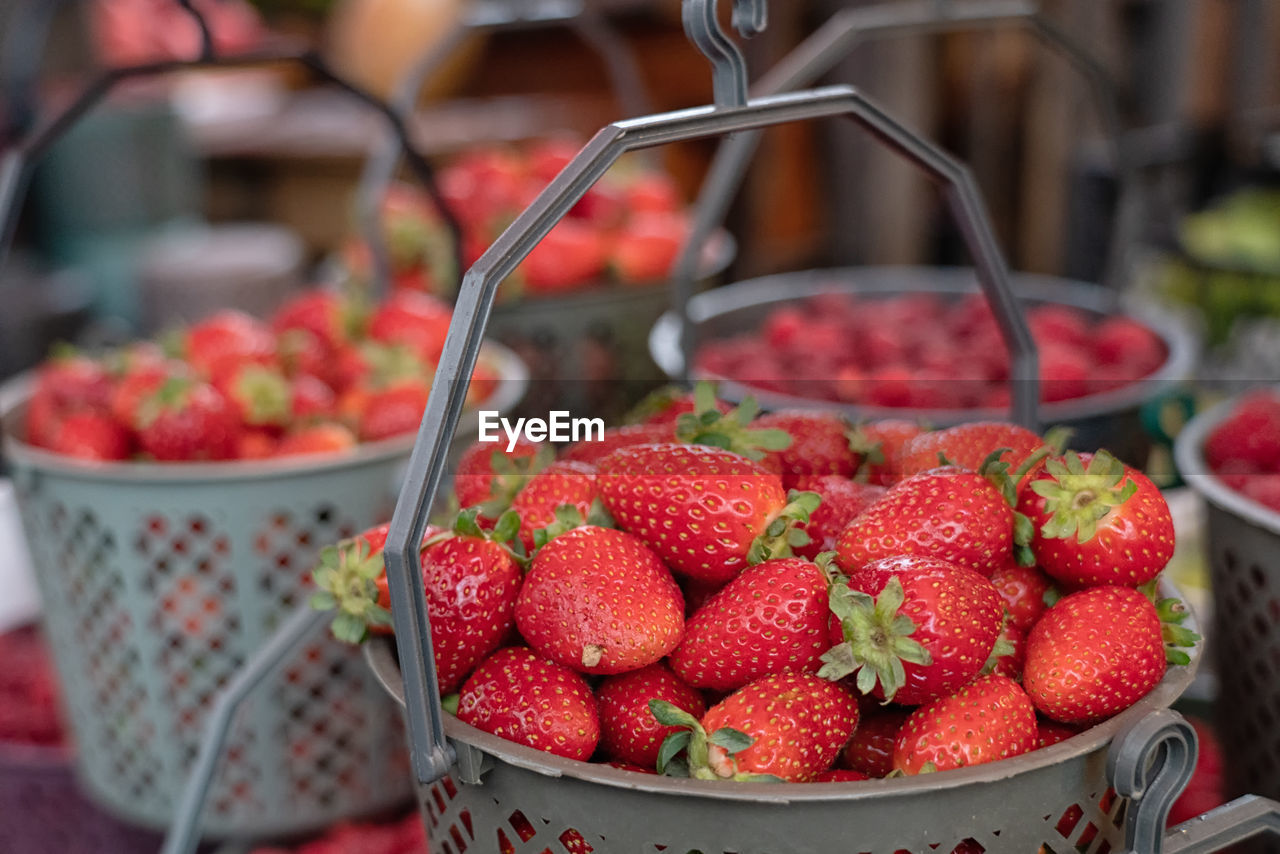 food, fruit, food and drink, berry fruit, strawberry, freshness, healthy eating, red, wellbeing, focus on foreground, close-up, large group of objects, container, for sale, market, market stall, retail, abundance, no people, still life, sale, ripe, retail display
