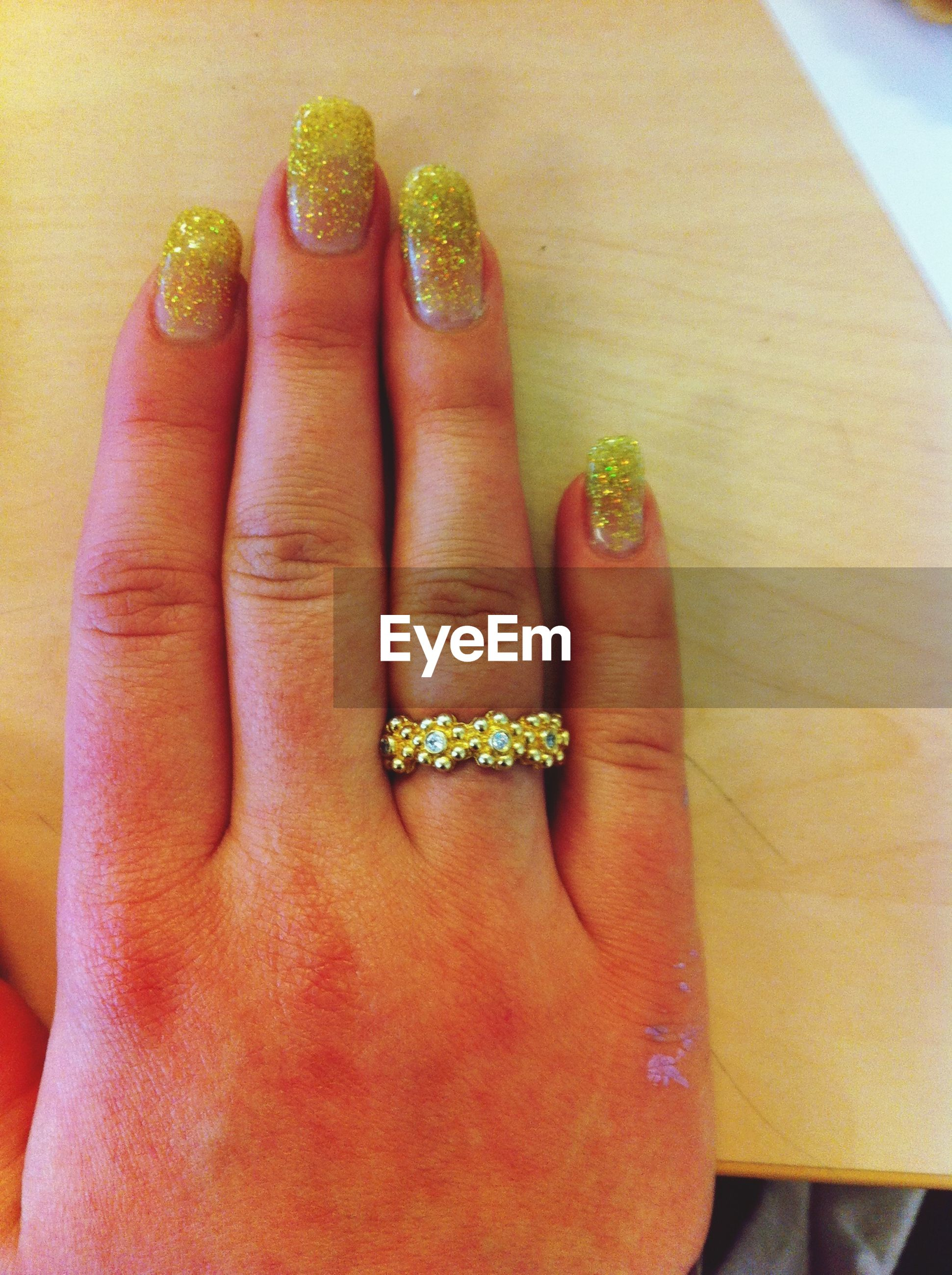 person, part of, indoors, human finger, holding, cropped, close-up, personal perspective, unrecognizable person, high angle view, freshness, showing, ring, nail polish, food and drink, palm
