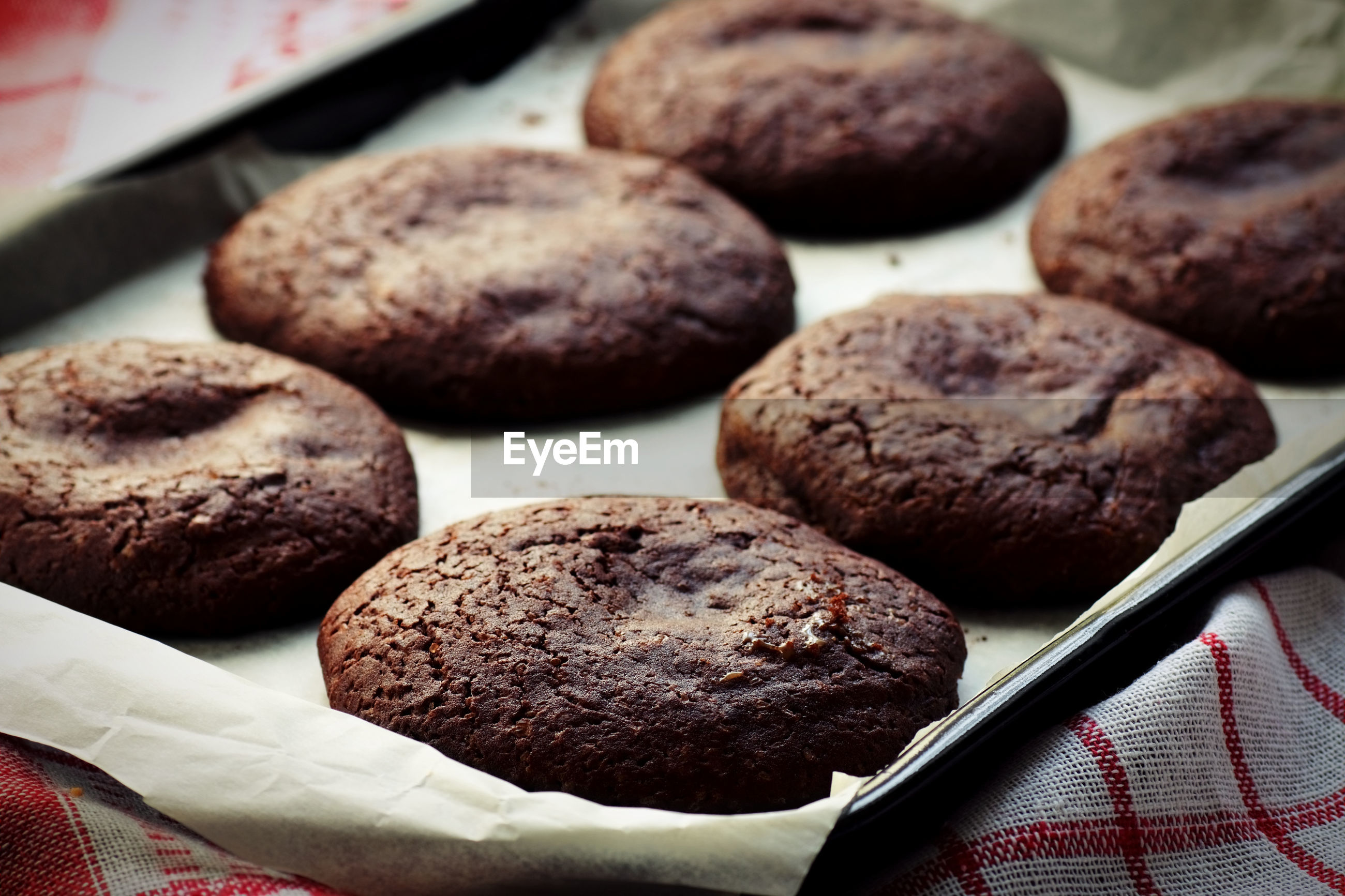Close-up of chocolate cookies in baking sheet on table