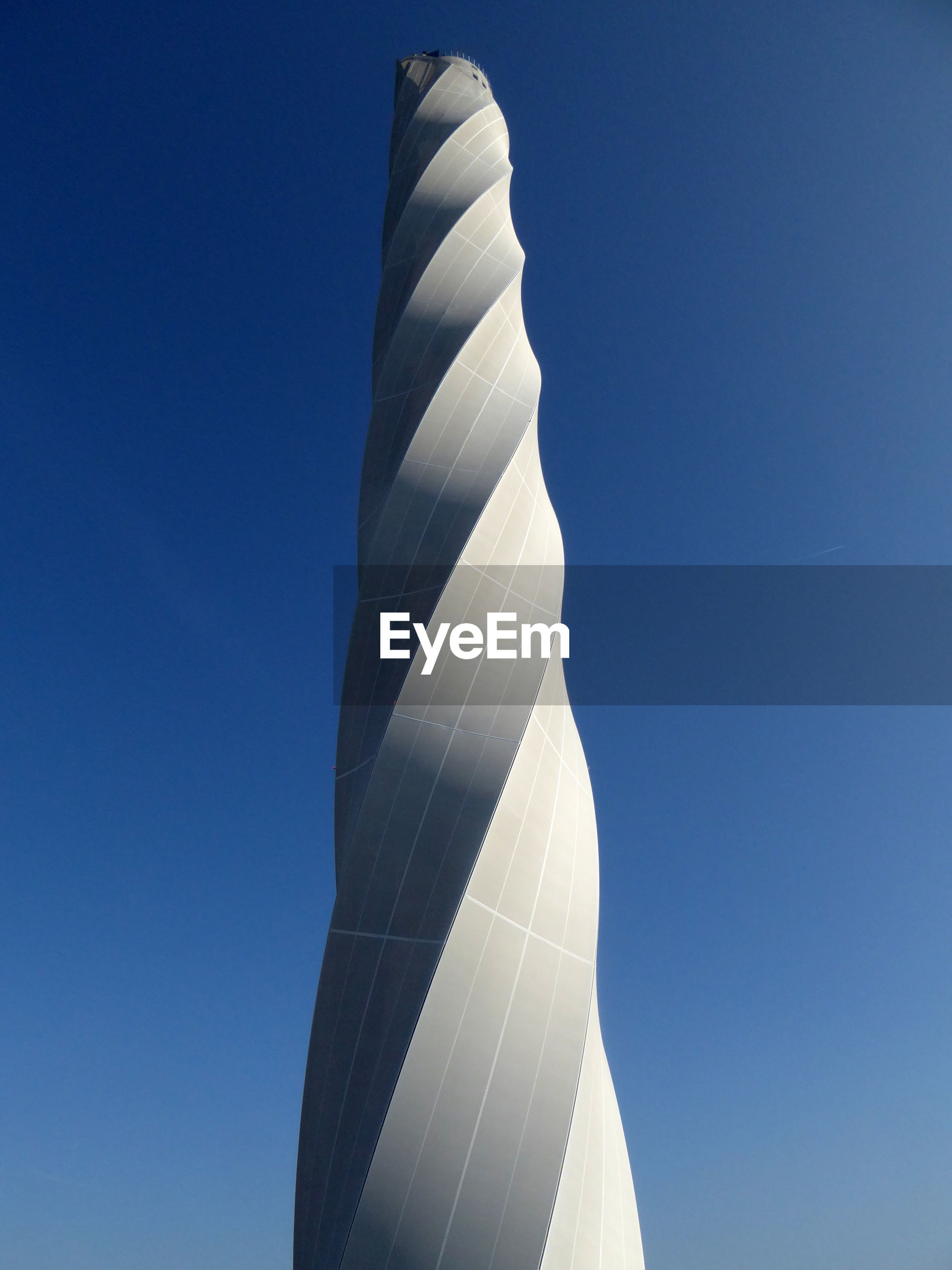 LOW ANGLE VIEW OF TOWER AGAINST BLUE SKY ON SUNNY DAY