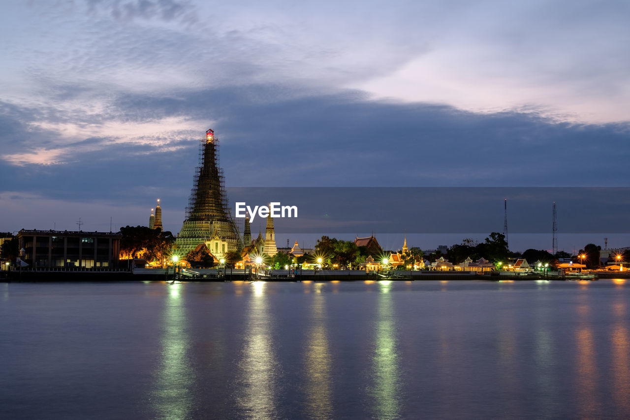 built structure, architecture, building exterior, sky, cloud - sky, water, waterfront, building, travel destinations, illuminated, tower, religion, no people, travel, belief, nature, city, place of worship, reflection, outdoors, spire, skyscraper