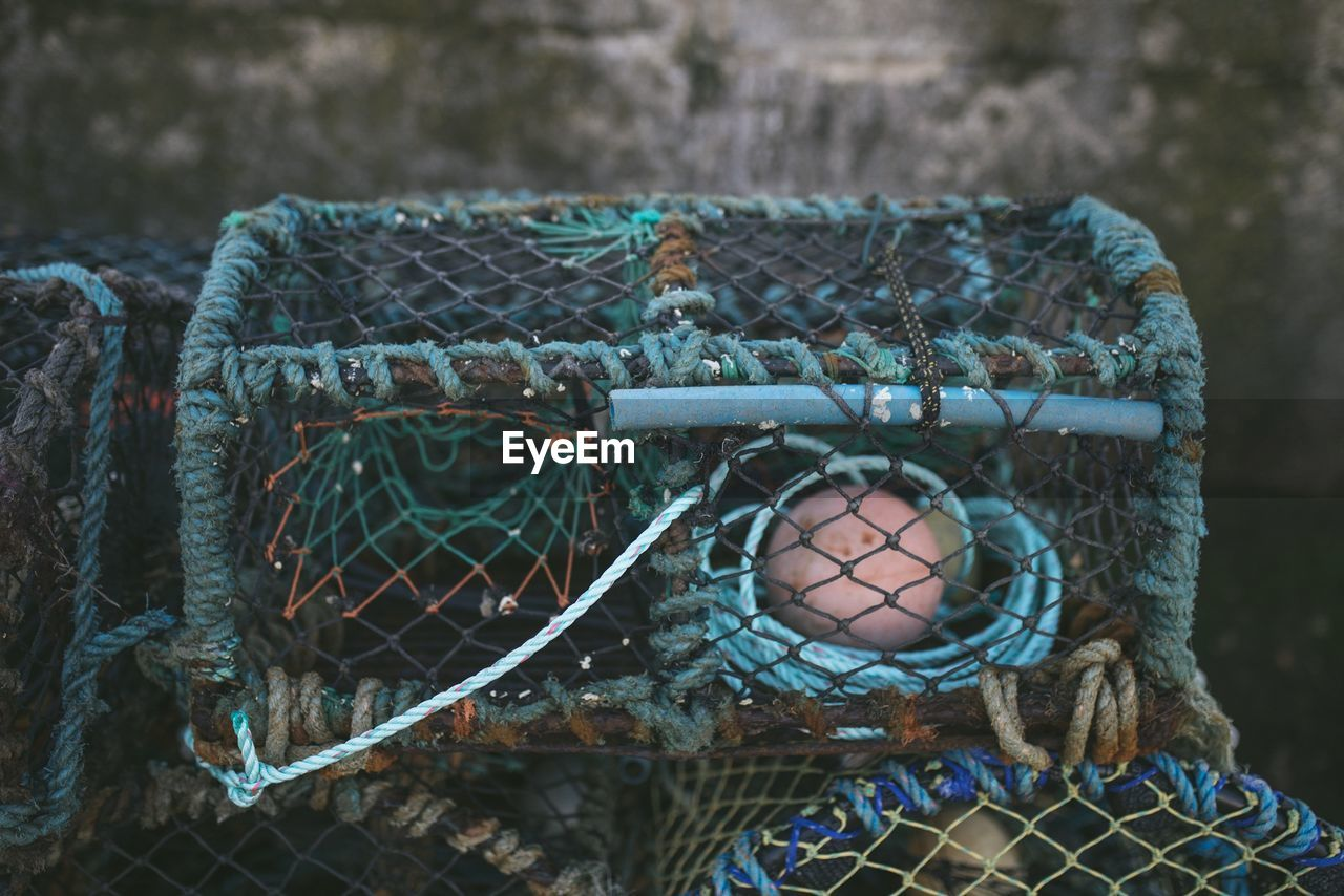 no people, close-up, day, focus on foreground, container, outdoors, basket, pattern, metal, food, still life, food and drink, netting, fishing, blue, fishing industry, nature, egg, design, fishing net, floral pattern