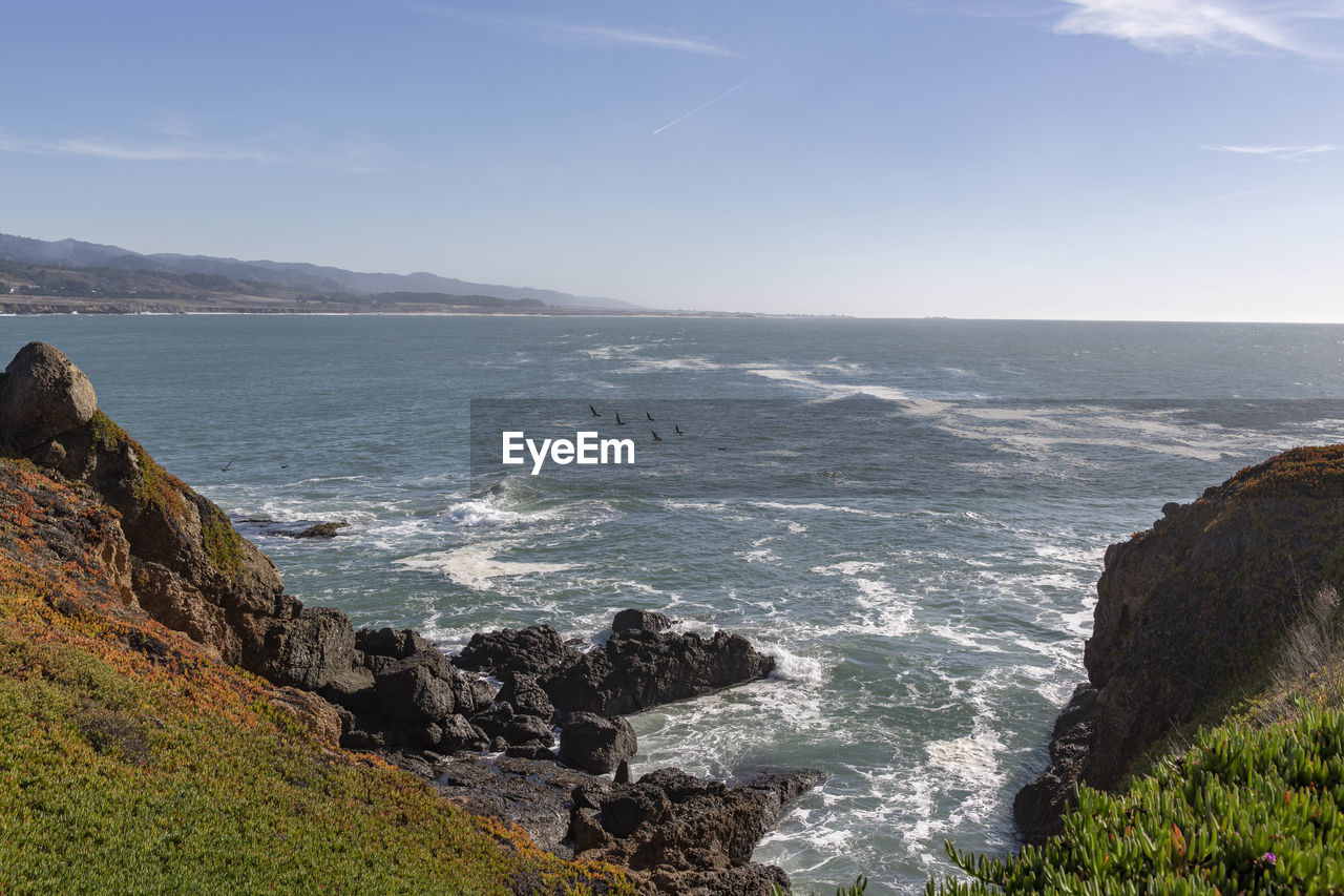 sea, water, beauty in nature, scenics - nature, sky, beach, land, rock, rock - object, nature, day, solid, mountain, no people, tranquil scene, tranquility, idyllic, wave, motion, outdoors, horizon over water, rocky coastline