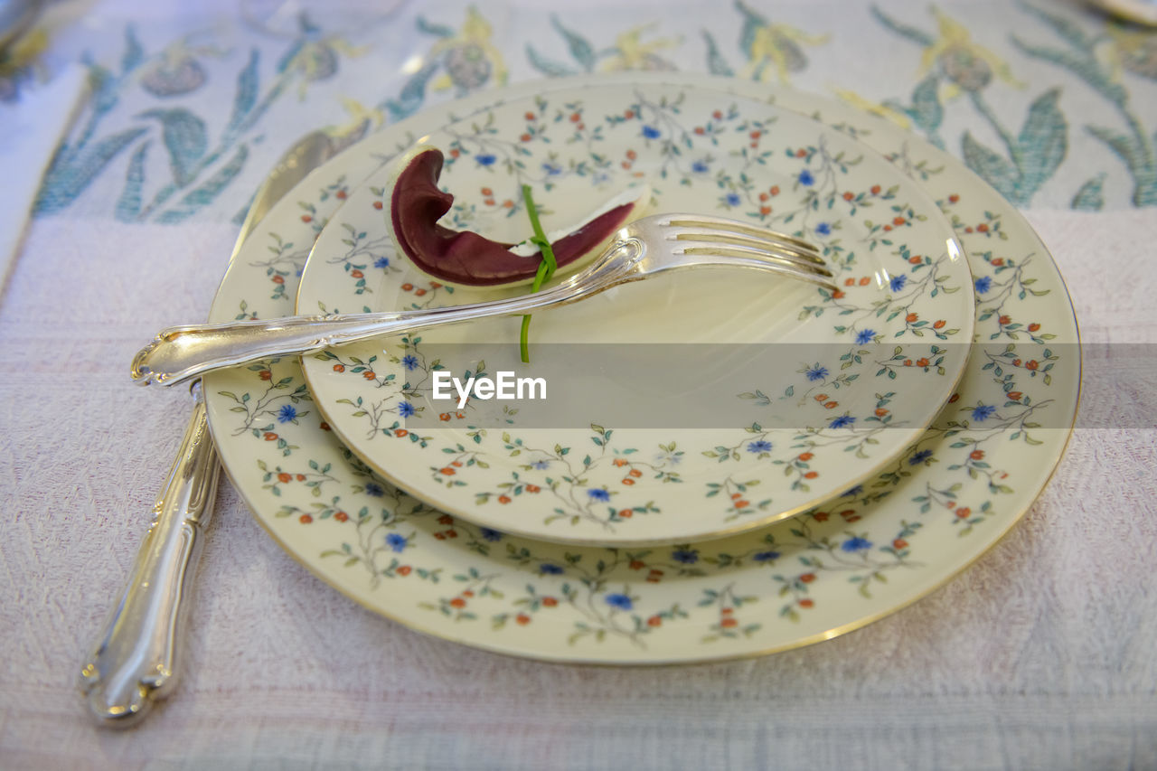 kitchen utensil, eating utensil, table, indoors, spoon, plate, still life, food and drink, freshness, food, close-up, high angle view, fork, no people, sweet food, indulgence, sweet, dessert, ready-to-eat, floral pattern, temptation, garnish, table knife