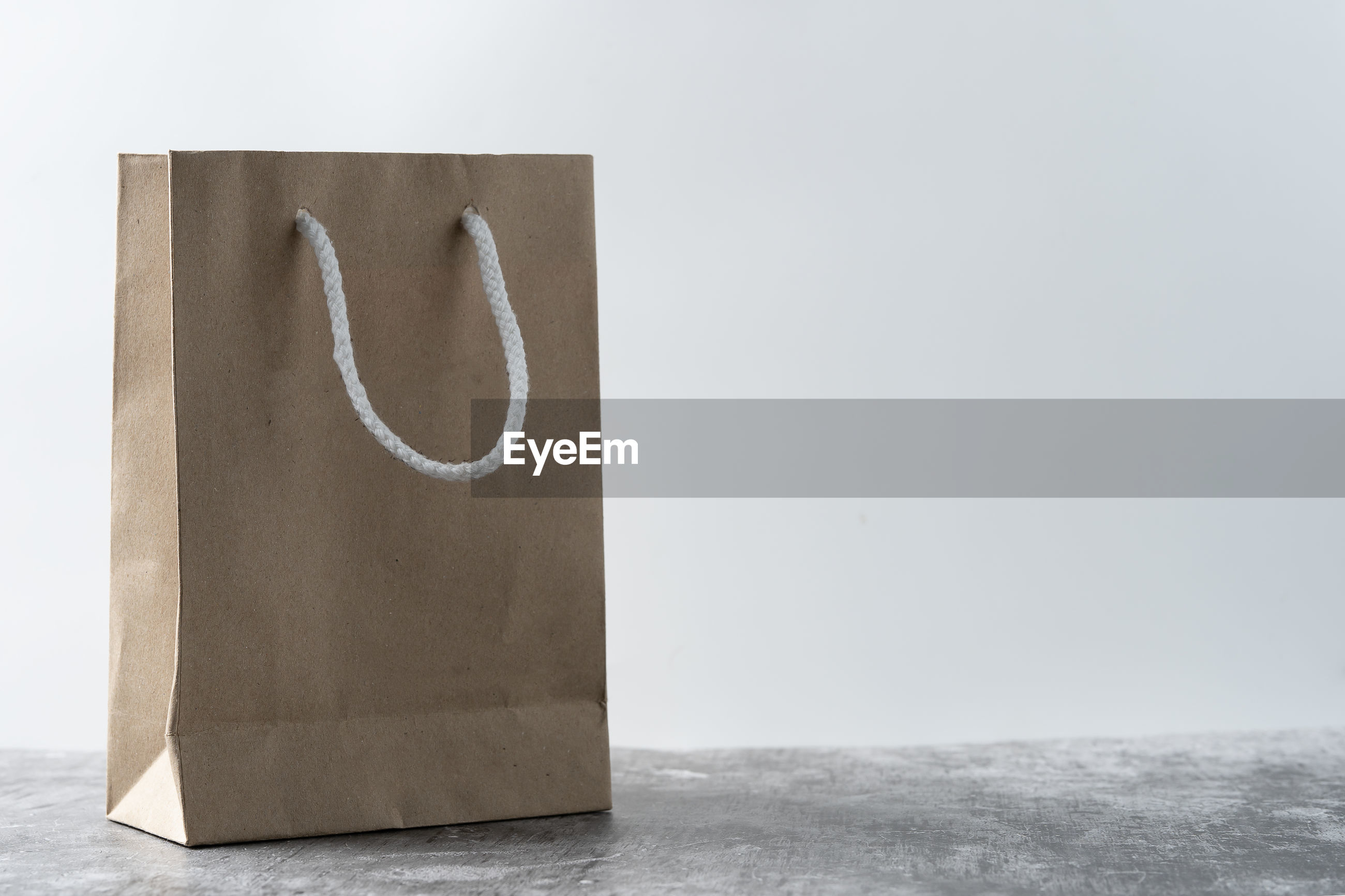 Close-up of paper bag on table
