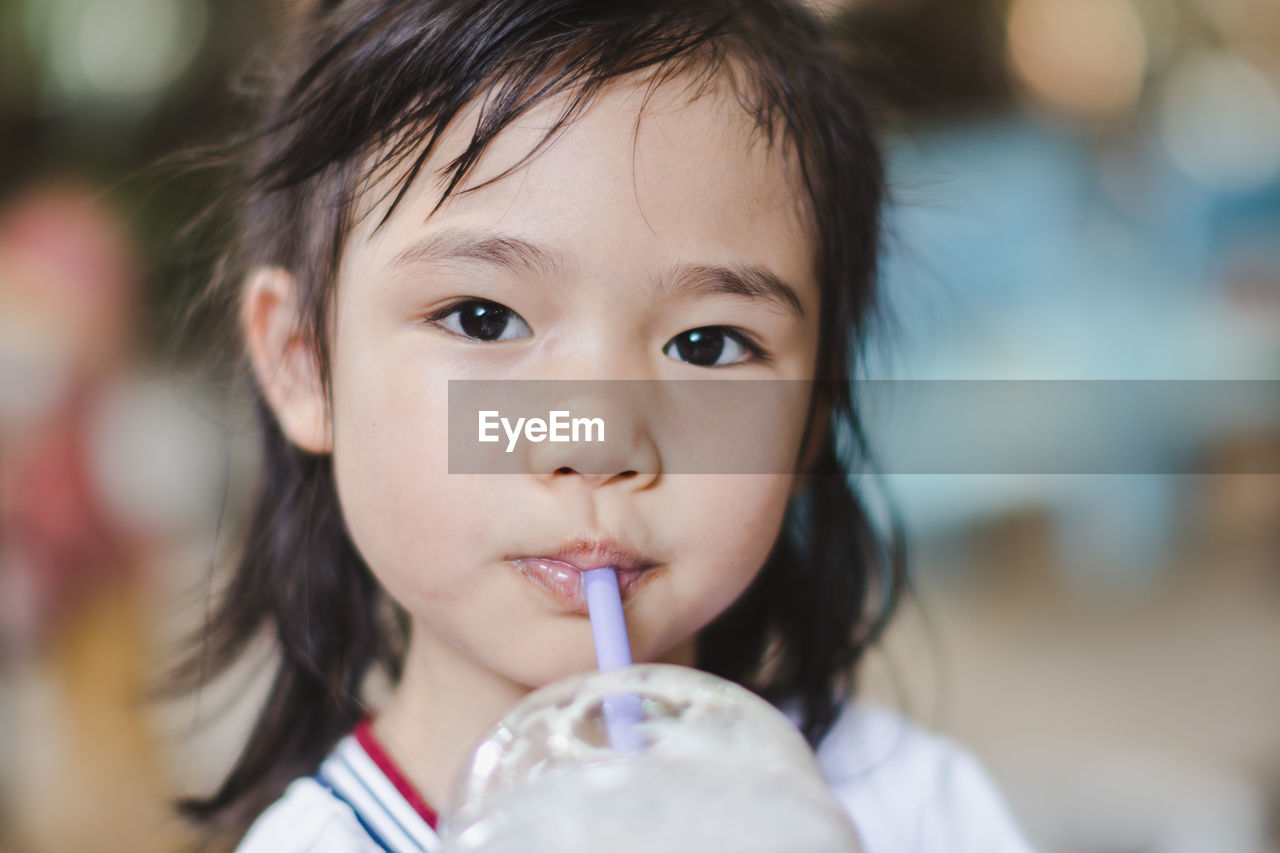 portrait, child, childhood, real people, headshot, one person, innocence, close-up, lifestyles, front view, focus on foreground, cute, looking at camera, food and drink, holding, females, straw, leisure activity, drinking