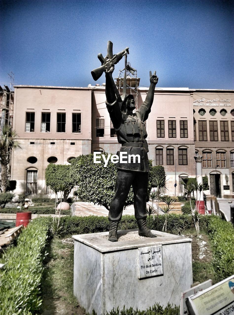 statue, sculpture, architecture, built structure, building exterior, human representation, monument, memorial, city, outdoors, day, no people