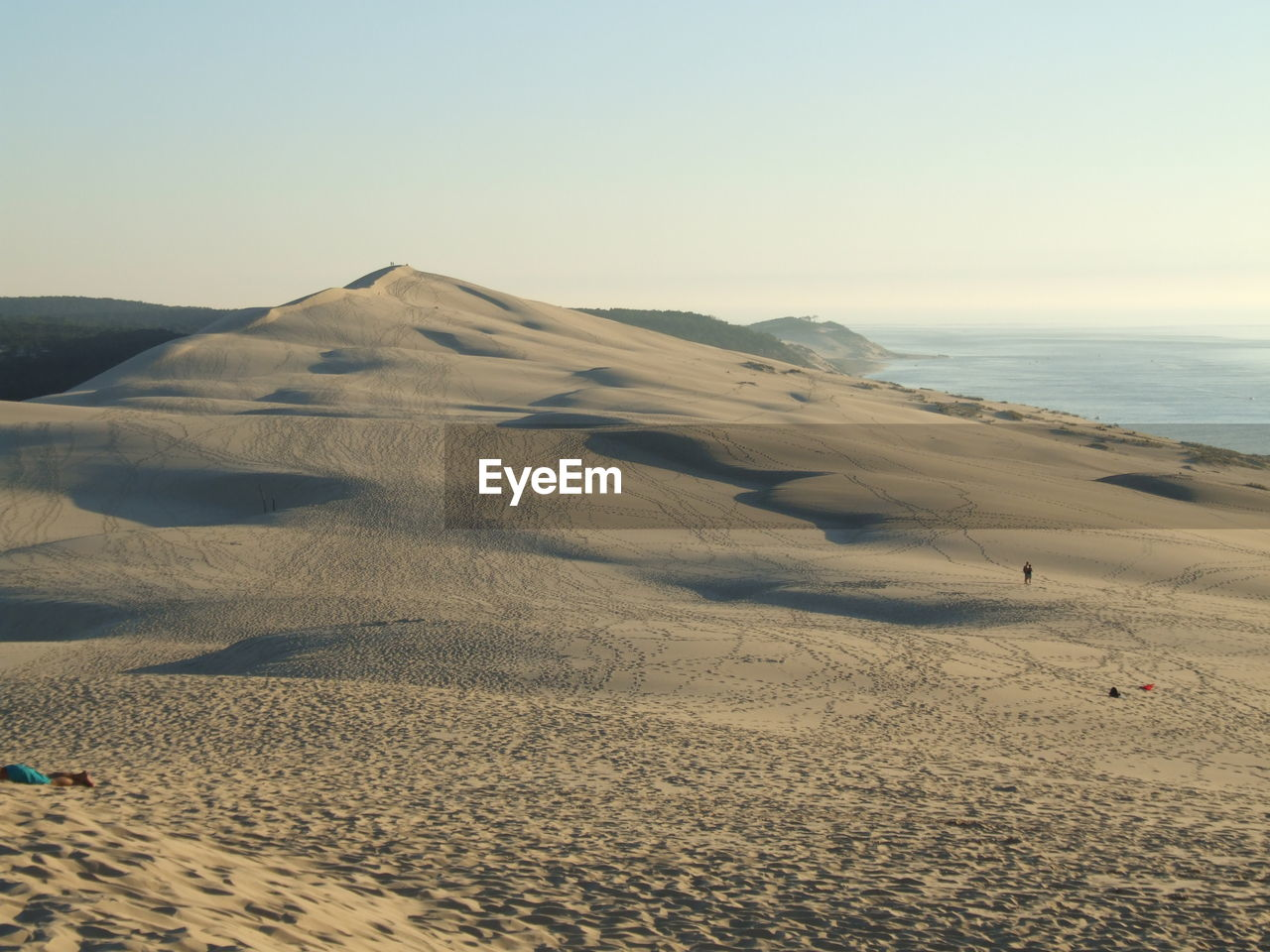 tranquil scene, scenics, nature, sand, tranquility, beauty in nature, outdoors, landscape, beach, day, clear sky, sand dune, sky, travel destinations, no people, sea, desert
