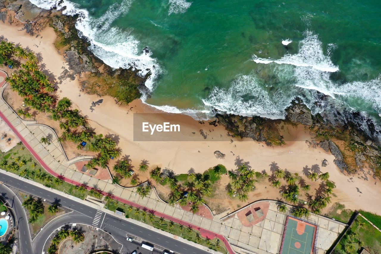 HIGH ANGLE VIEW OF ROAD BY BEACH