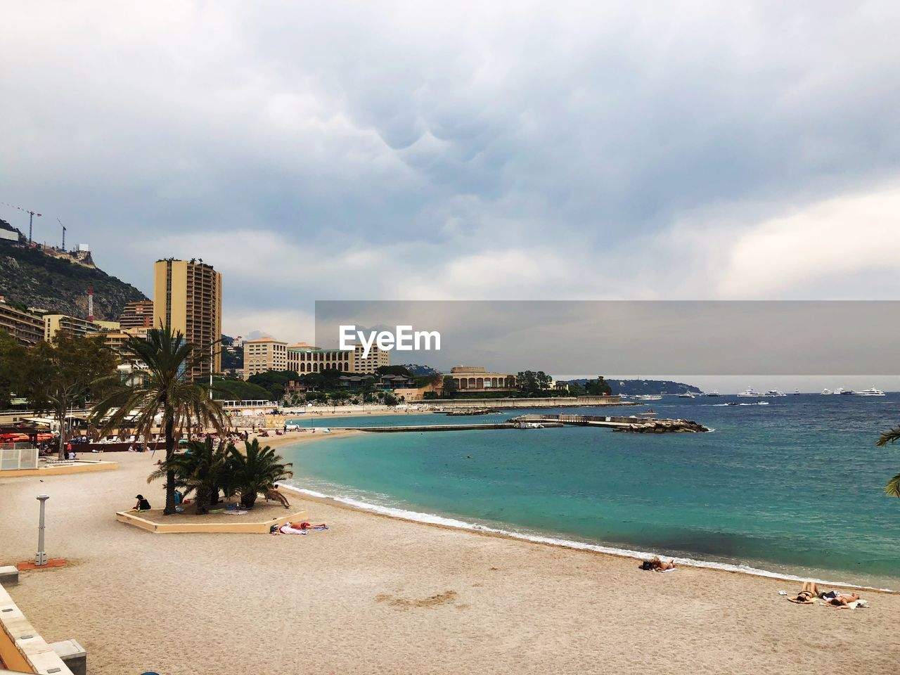 water, sea, sky, beach, cloud - sky, land, architecture, nature, building exterior, built structure, city, sand, day, incidental people, tree, beauty in nature, plant, outdoors, scenics - nature