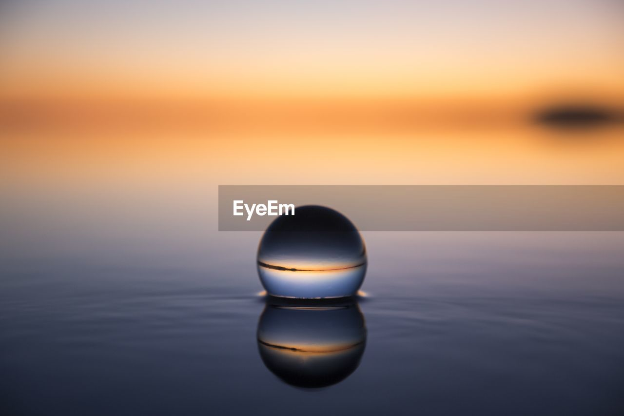 Close-Up Of Water Against Sky During Sunset