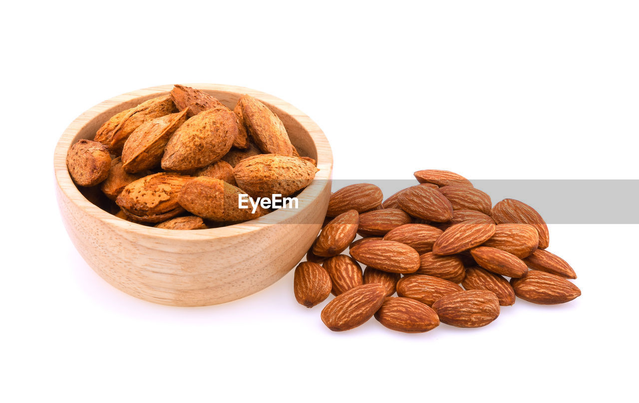 studio shot, white background, still life, food and drink, food, nut, indoors, healthy eating, nut - food, wellbeing, almond, brown, no people, large group of objects, freshness, close-up, bowl, cut out, walnut, fruit, snack
