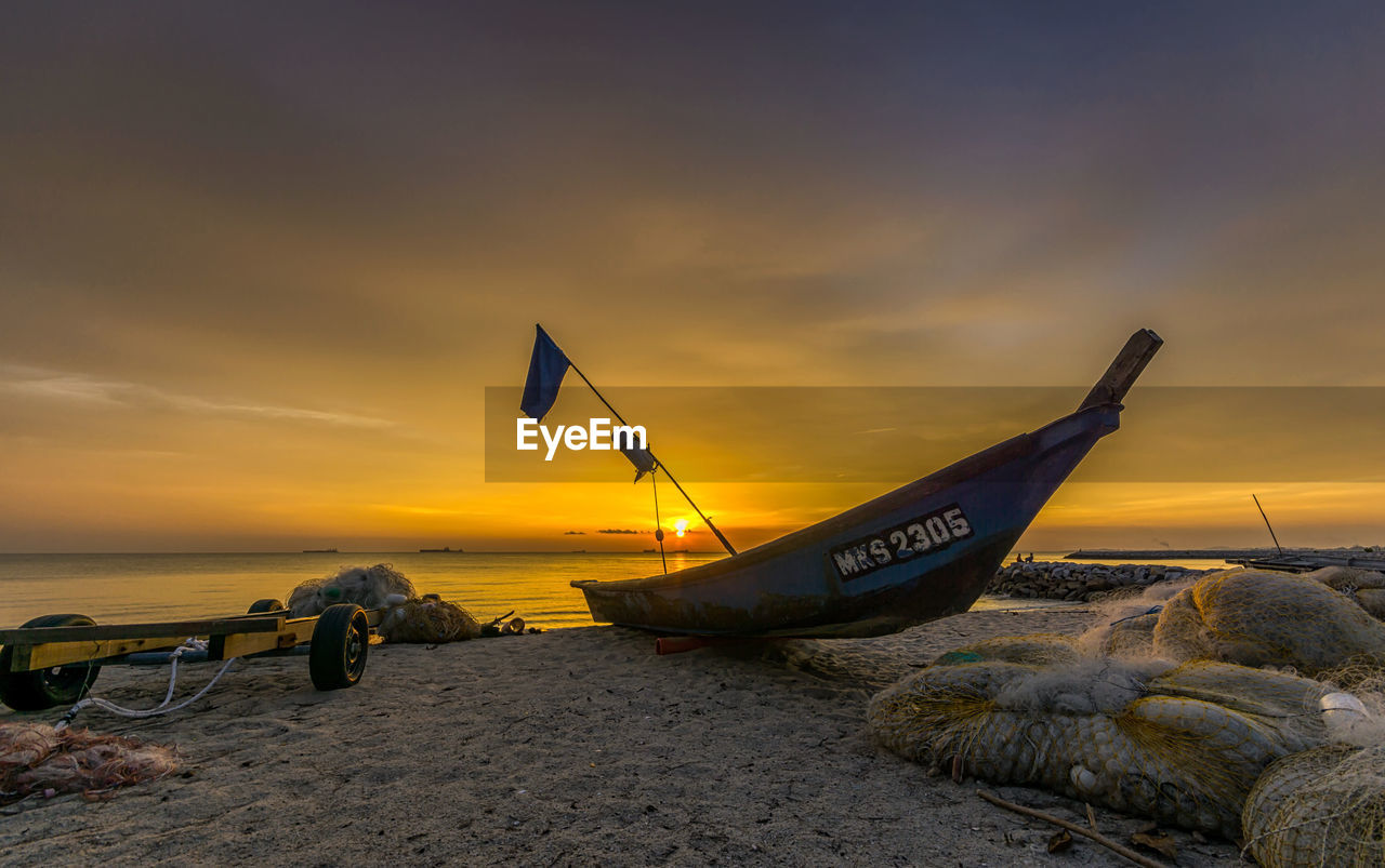sunset, sky, water, nautical vessel, transportation, sea, mode of transportation, cloud - sky, scenics - nature, beach, nature, orange color, beauty in nature, moored, land, tranquility, tranquil scene, horizon, horizon over water, no people, outdoors, fishing boat