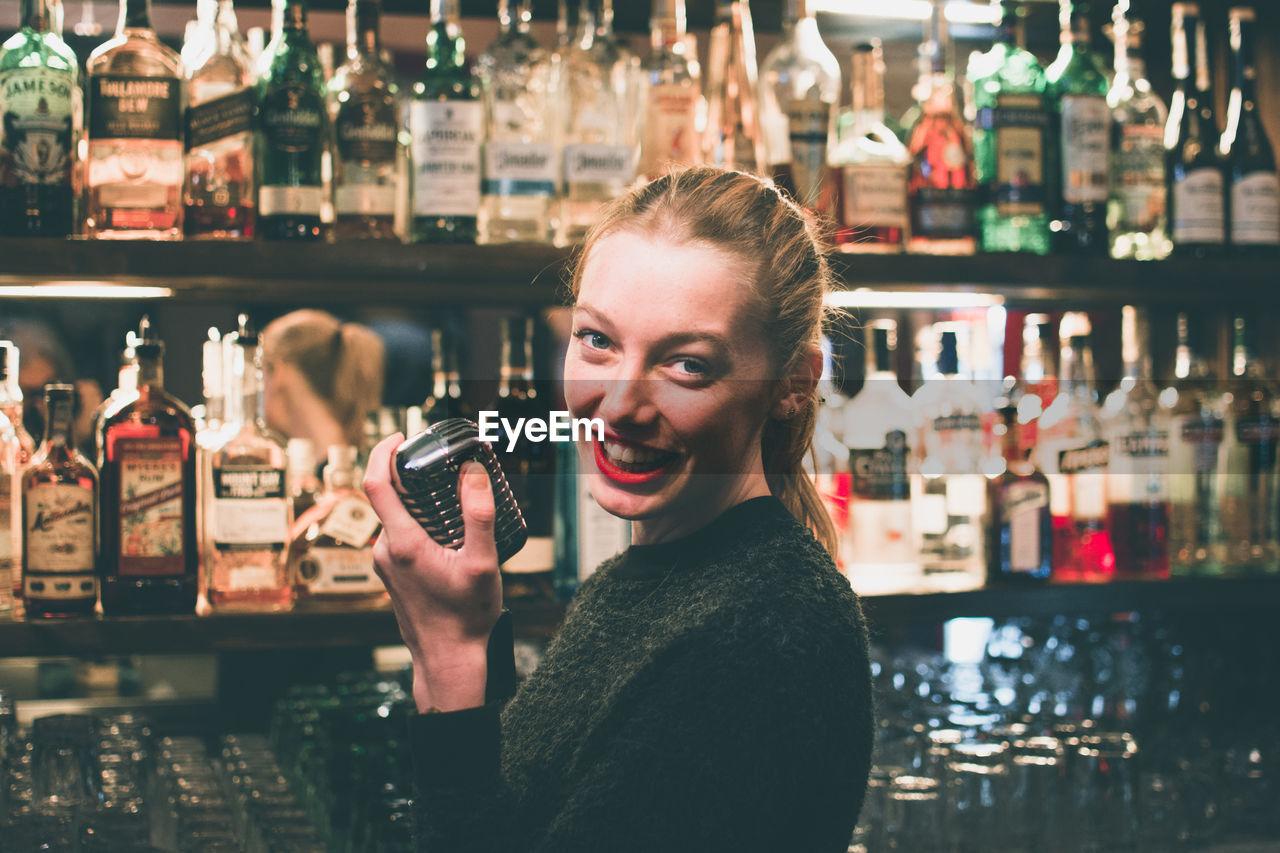 Portrait of woman in bar