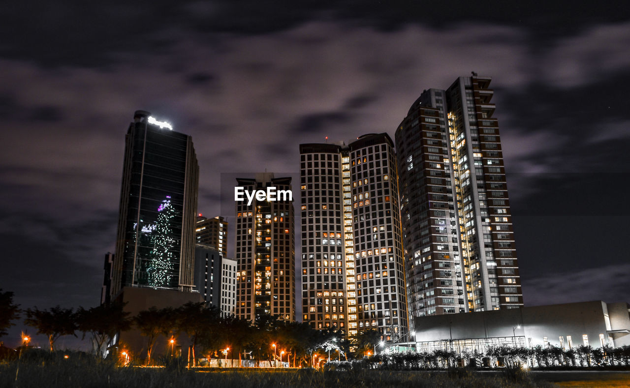 building exterior, night, illuminated, architecture, built structure, city, sky, building, office building exterior, cloud - sky, skyscraper, cityscape, nature, no people, tall - high, modern, office, low angle view, urban skyline, outdoors, financial district