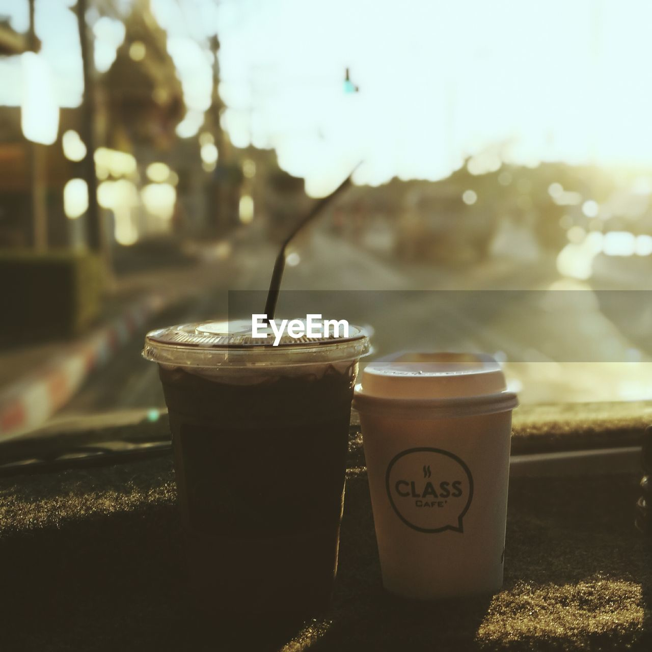 drink, refreshment, coffee - drink, drinking straw, food and drink, coffee cup, focus on foreground, no people, freshness, disposable cup, table, close-up, drinking glass, iced coffee, outdoors, latte, day, frothy drink, nature, sky