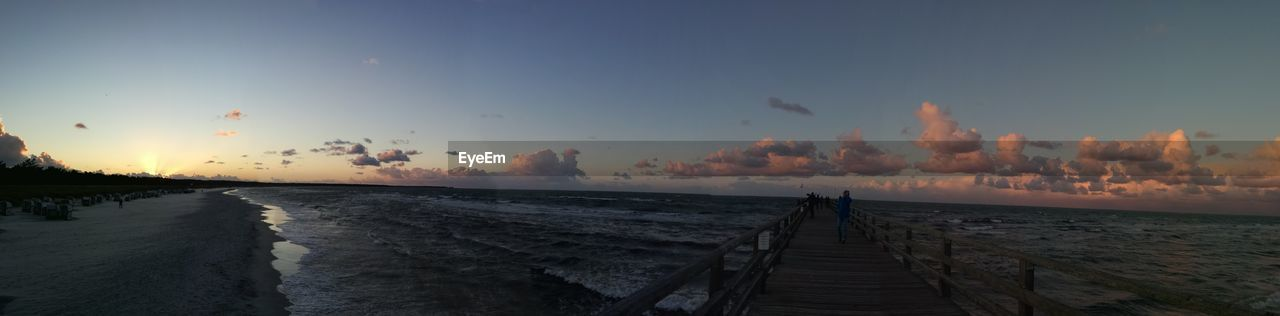sky, sunset, water, sea, scenics - nature, beauty in nature, nature, cloud - sky, tranquility, tranquil scene, direction, the way forward, orange color, horizon over water, beach, horizon, land, pier, motion, no people, outdoors