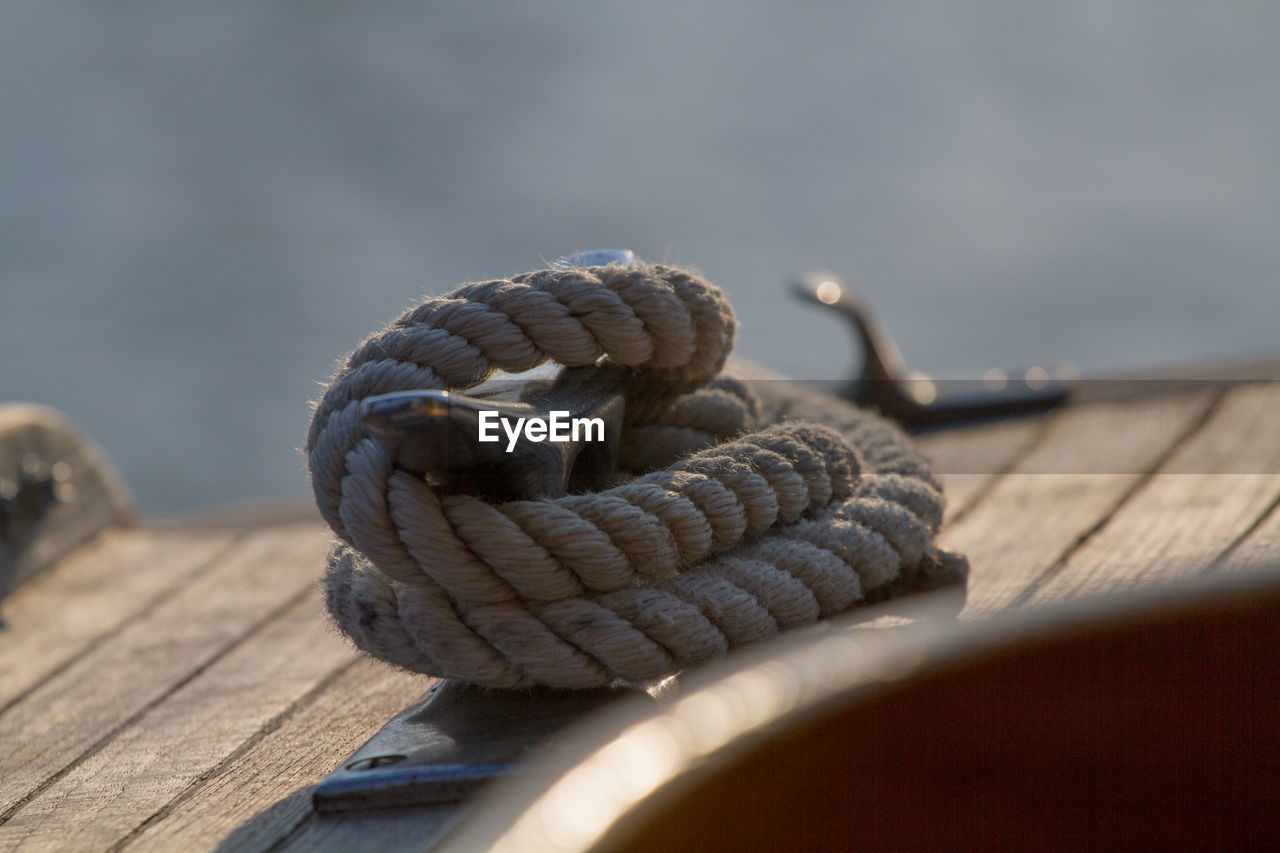 rope, pier, wood - material, no people, strength, outdoors, close-up, selective focus, day, cleat, nature