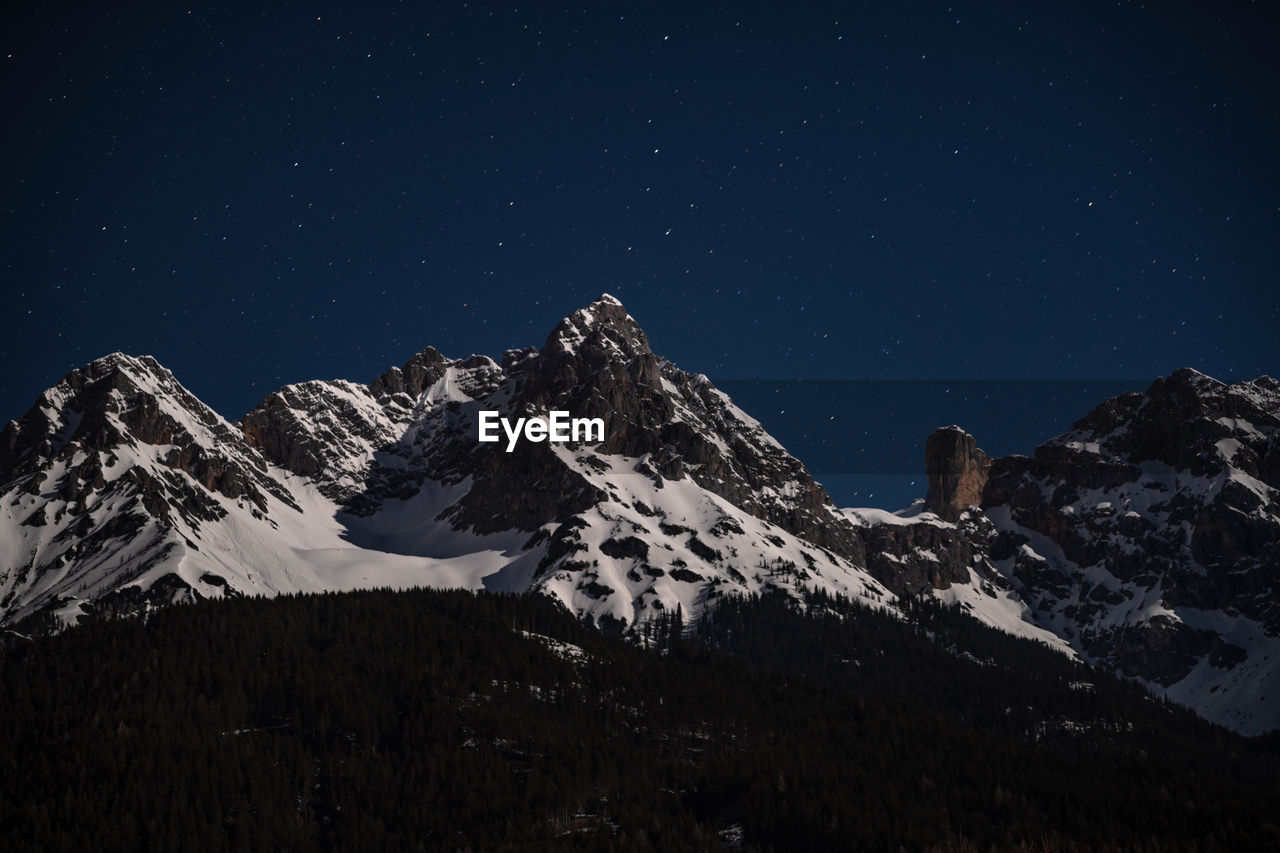 scenics - nature, sky, snow, mountain, beauty in nature, winter, star - space, tranquil scene, night, snowcapped mountain, cold temperature, tranquility, mountain range, astronomy, nature, space, idyllic, no people, mountain peak, outdoors, formation