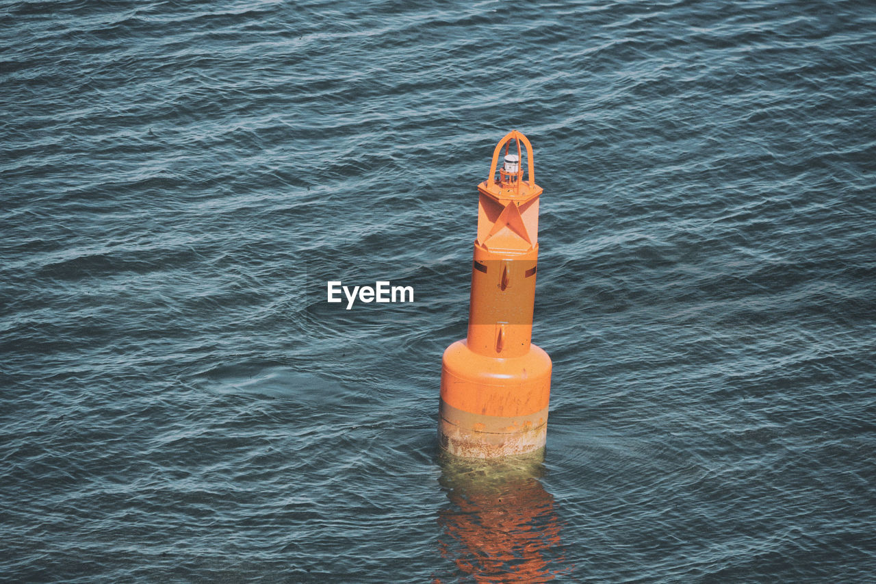 water, sea, day, no people, floating, floating on water, safety, nature, rippled, orange color, protection, security, outdoors, high angle view, sunlight, waterfront, single object, buoy, inflatable