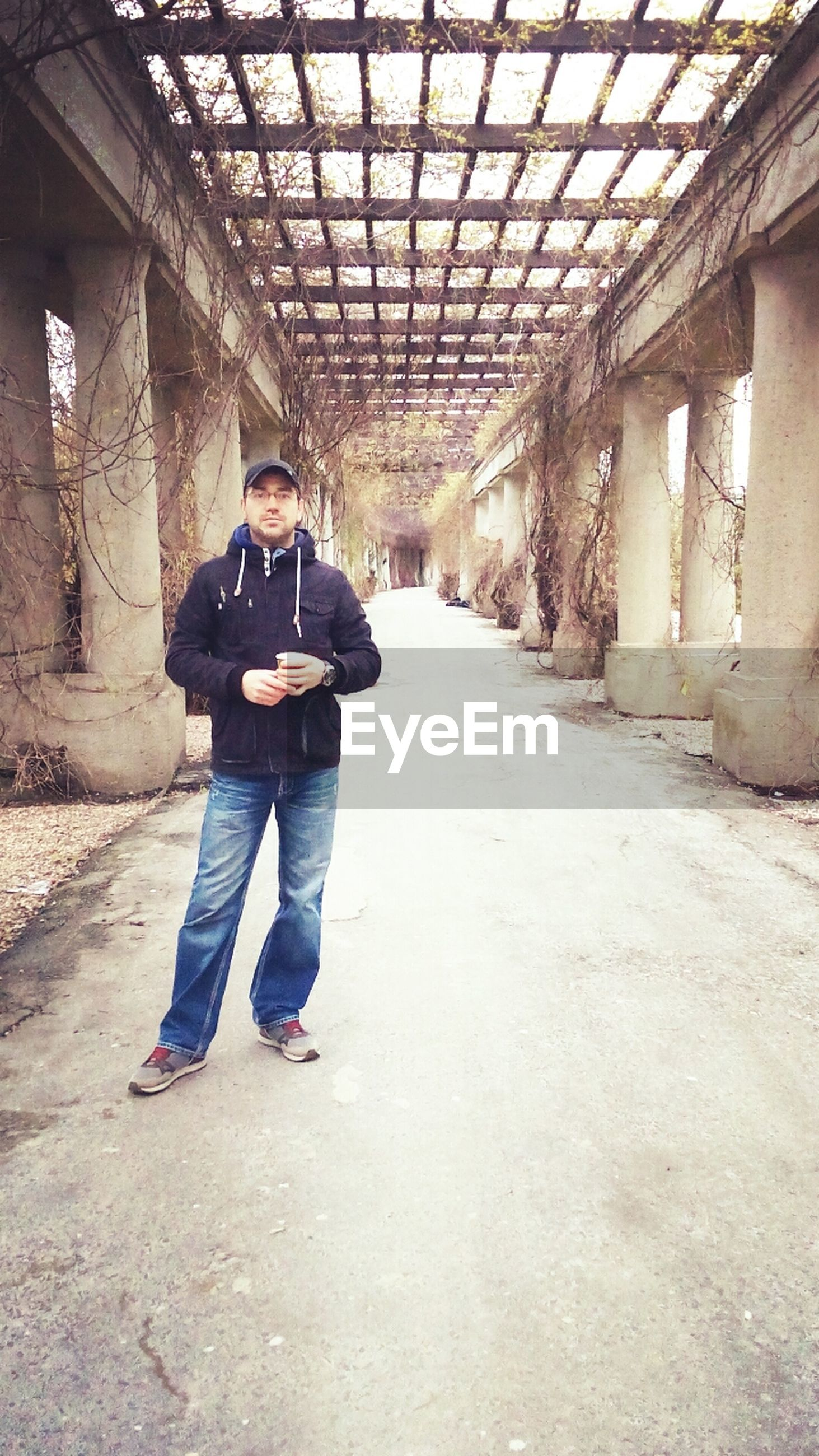 full length, architecture, built structure, lifestyles, the way forward, casual clothing, building exterior, walking, leisure activity, rear view, person, men, diminishing perspective, vanishing point, standing, day, building