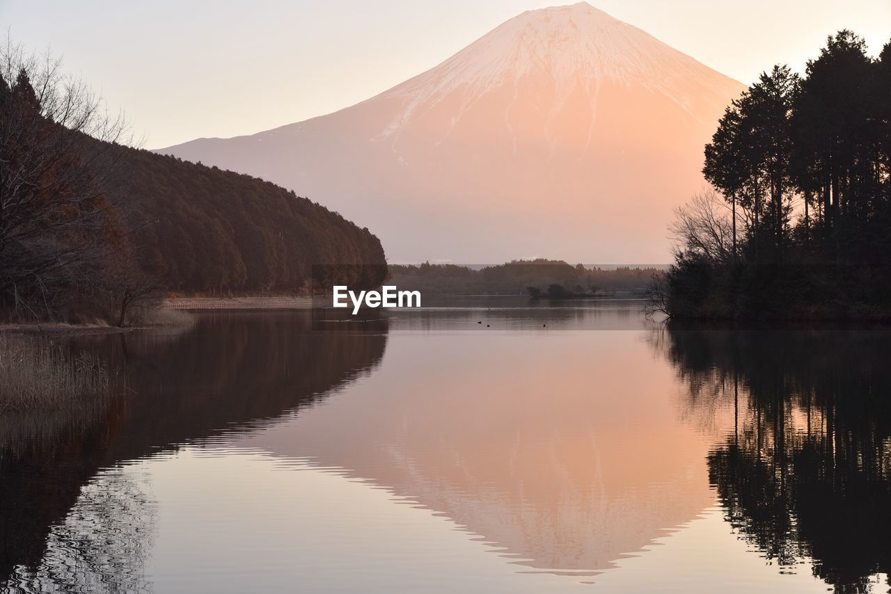 reflection, scenics, tree, water, tranquil scene, lake, mountain, beauty in nature, nature, no people, tranquility, sky, sunset, outdoors, mountain range, landscape, day