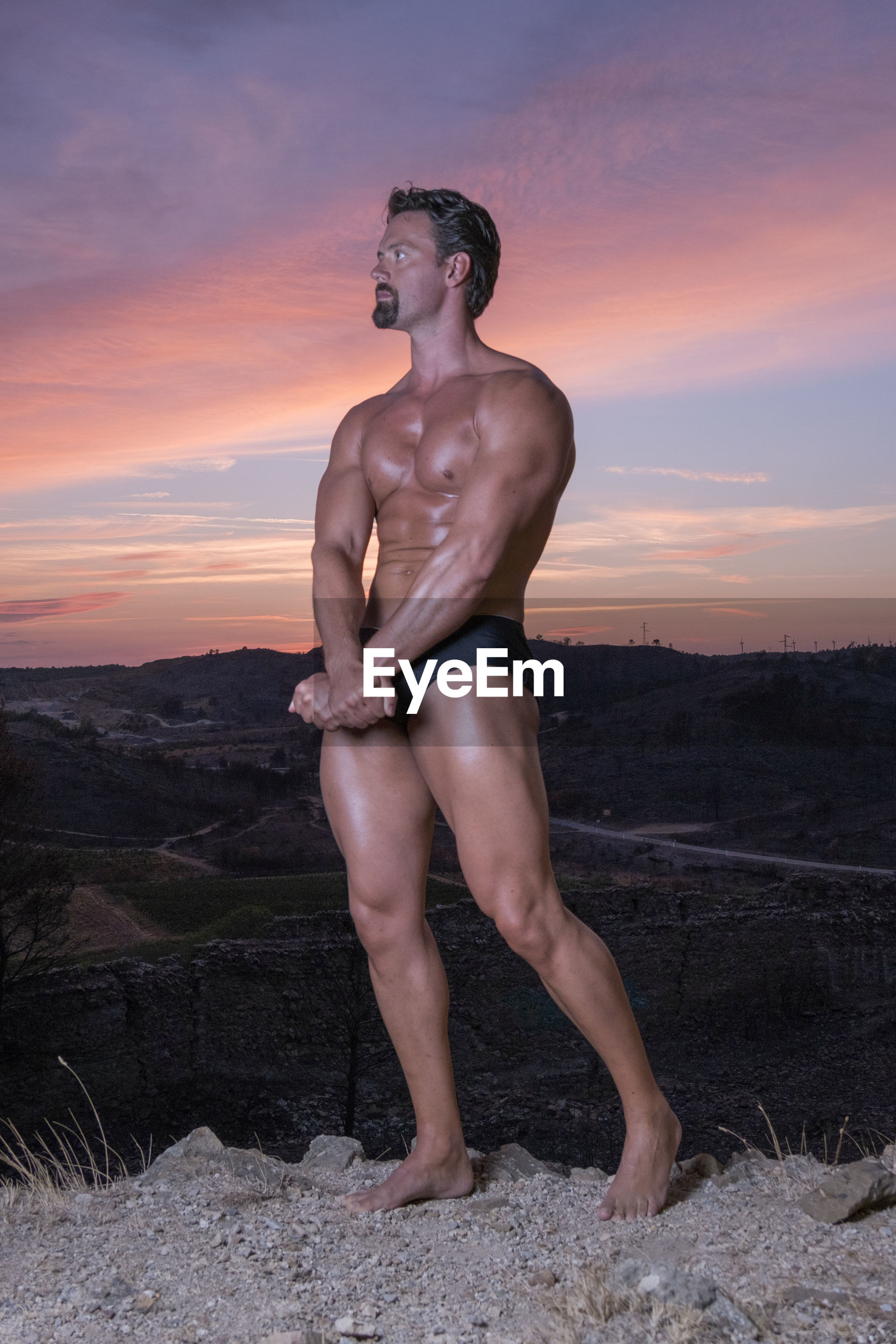 Silhouette of a bodybuilder at sunset