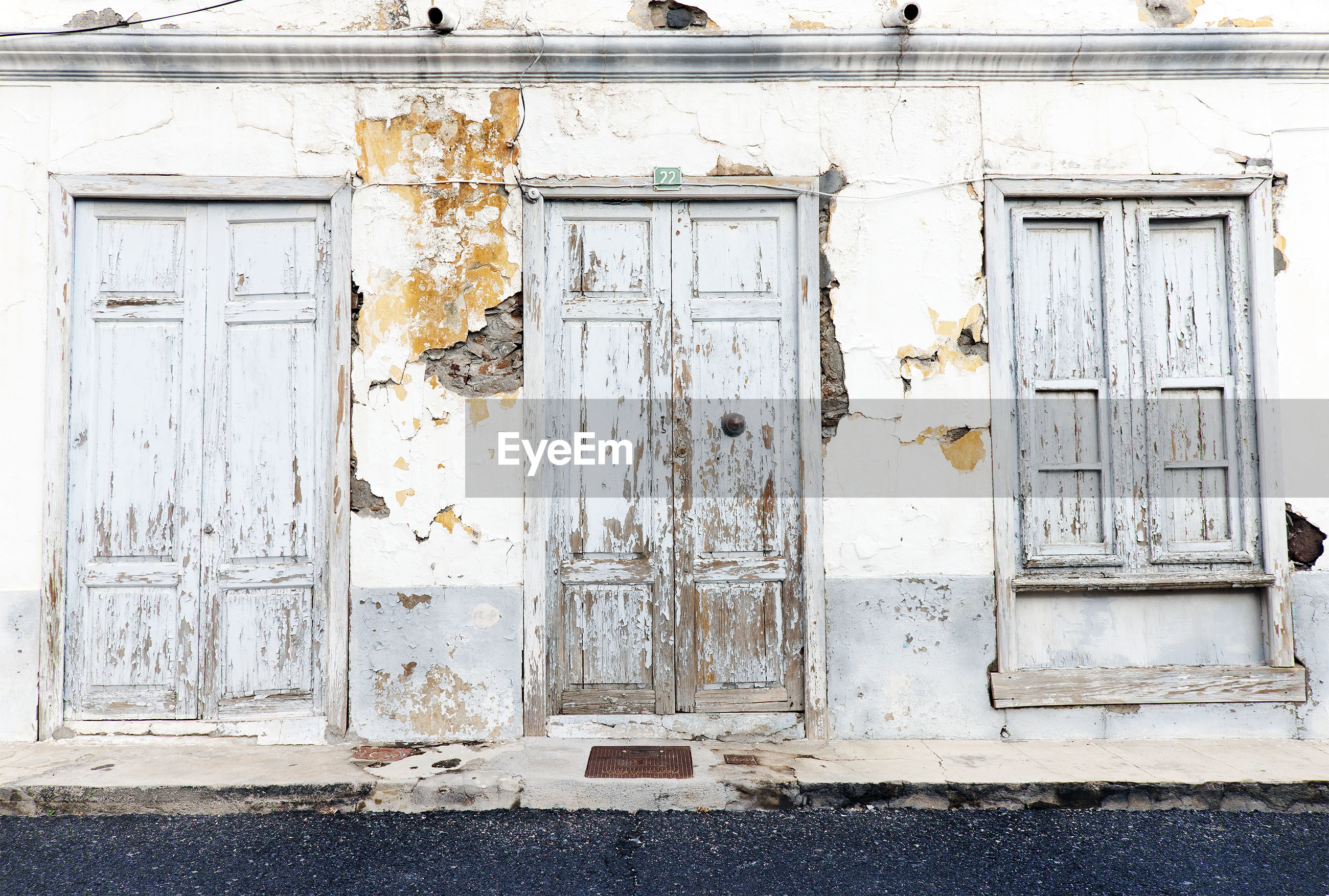 Weathered wooden entrance doors of building