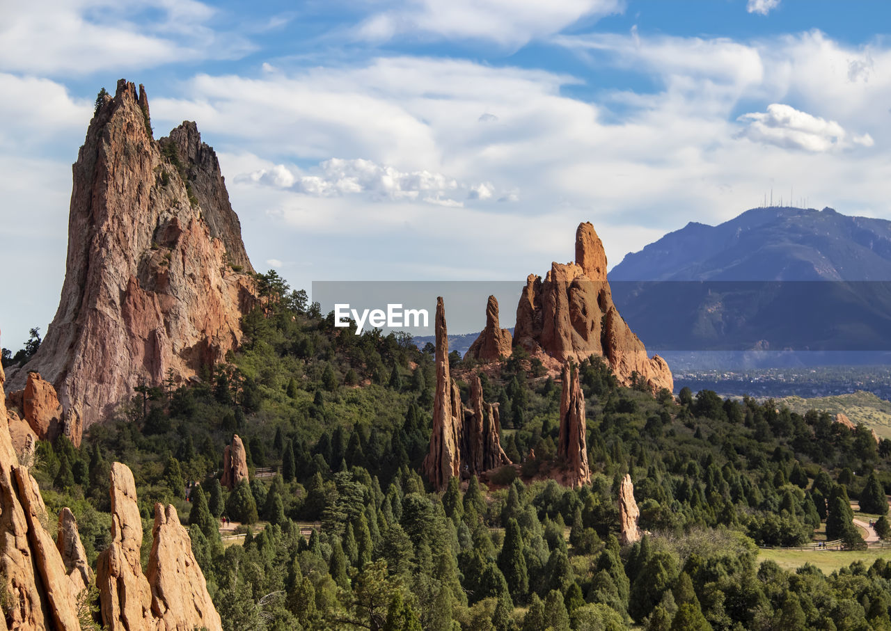 mountain, rock, sky, beauty in nature, cloud - sky, scenics - nature, rock - object, tranquil scene, rock formation, solid, tranquility, mountain range, nature, non-urban scene, plant, landscape, land, geology, travel destinations, tree, formation, outdoors, eroded