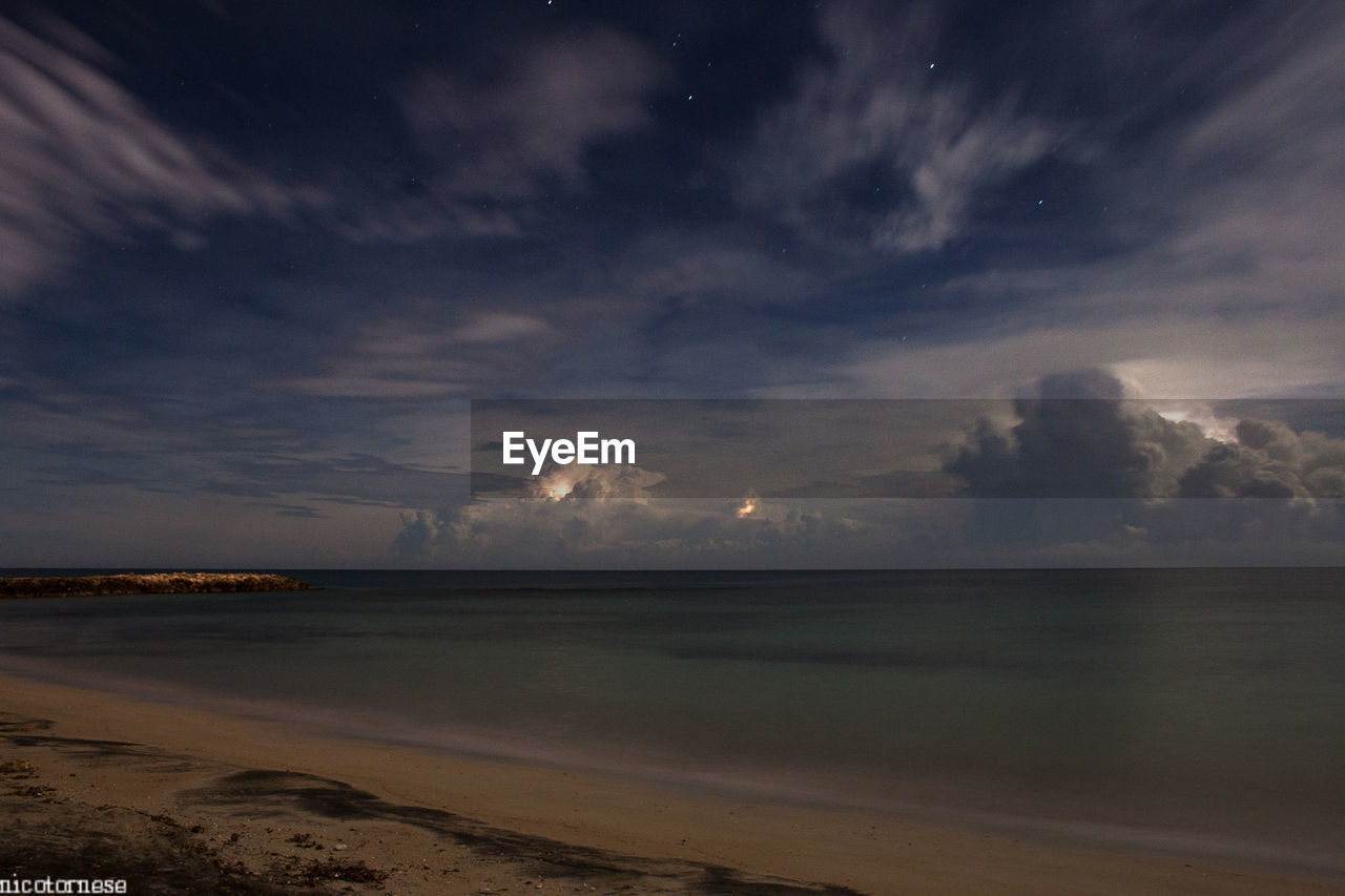sea, sky, cloud - sky, scenics, beauty in nature, water, tranquility, nature, sunset, horizon over water, tranquil scene, beach, no people, outdoors, day