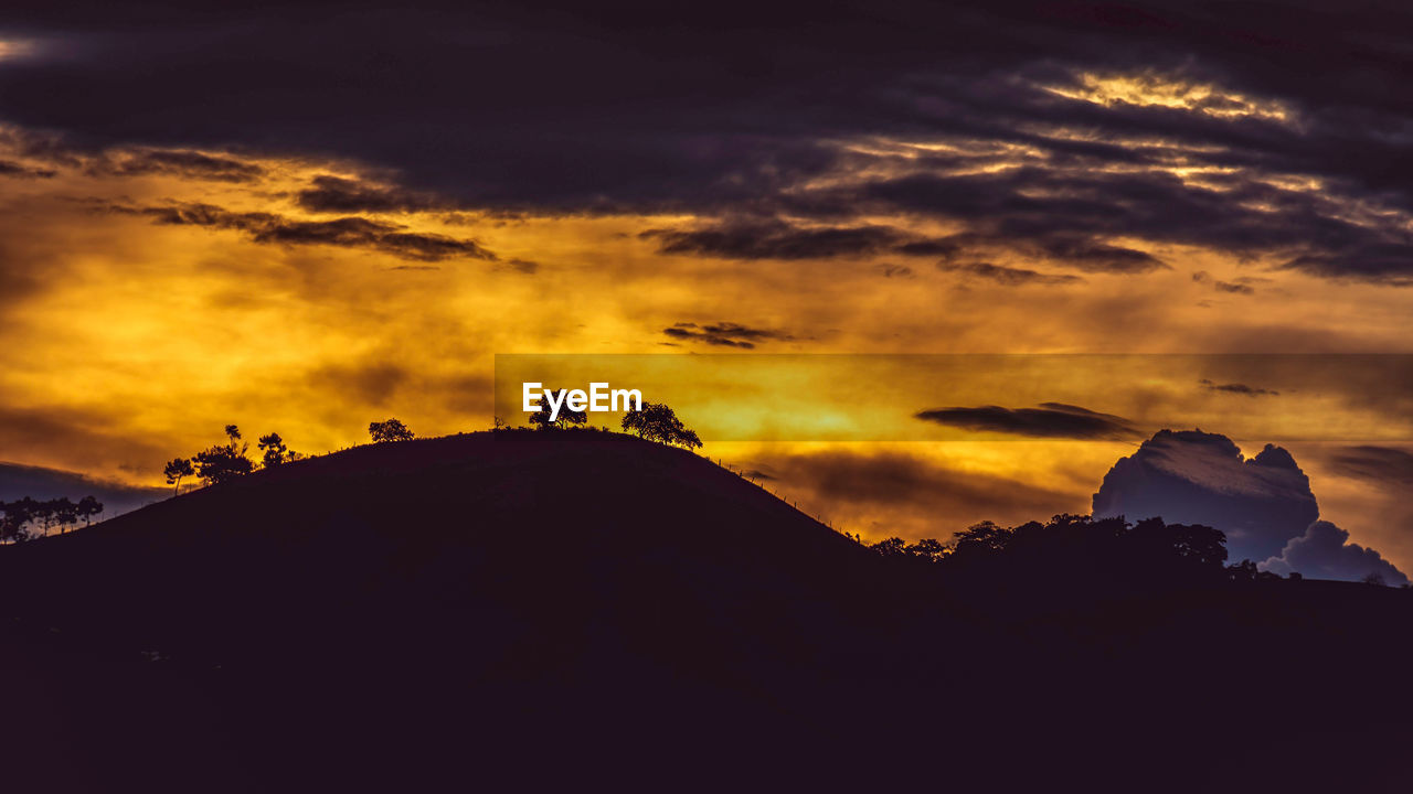sky, cloud - sky, sunset, silhouette, beauty in nature, scenics - nature, tranquility, tranquil scene, nature, orange color, no people, idyllic, environment, mountain, non-urban scene, outdoors, dramatic sky, low angle view, dark