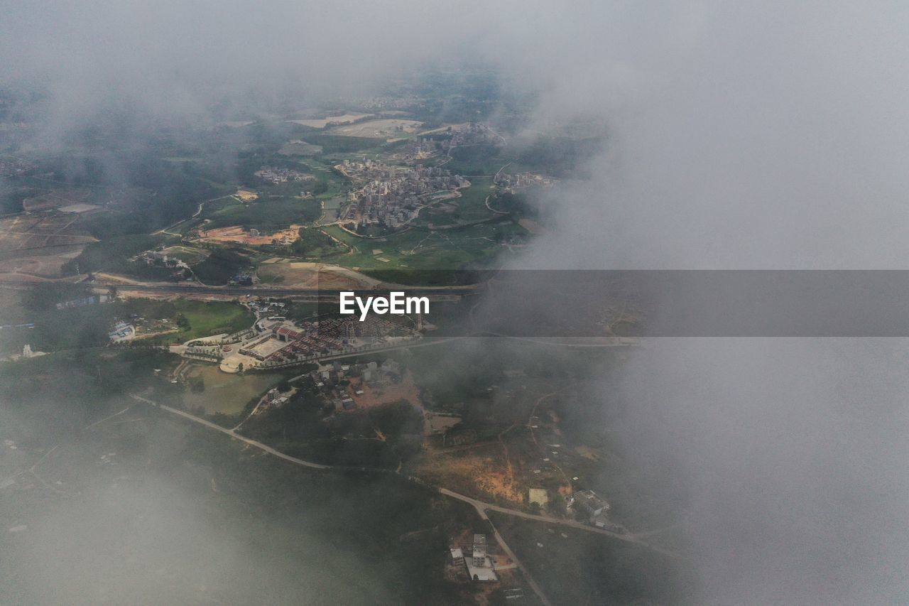 HIGH ANGLE VIEW OF LANDSCAPE AGAINST SKY DURING FOGGY WEATHER