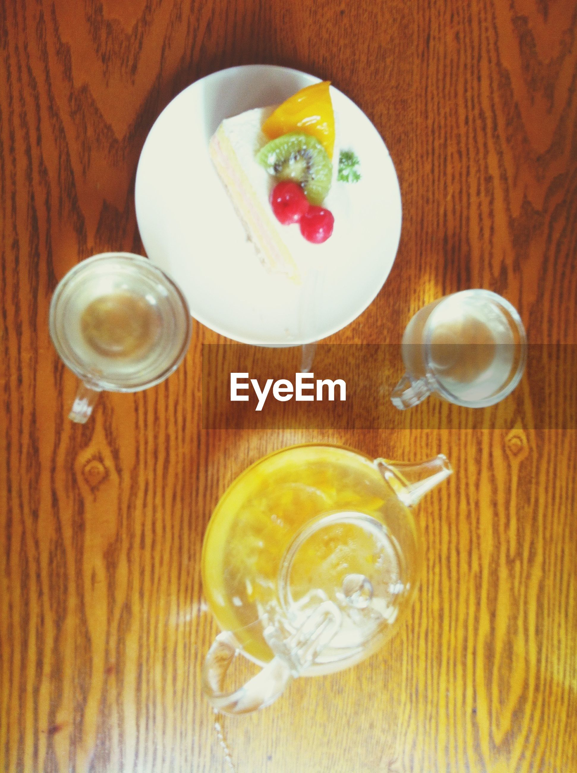food and drink, table, indoors, freshness, food, still life, drink, refreshment, plate, healthy eating, ready-to-eat, high angle view, directly above, drinking glass, wood - material, slice, fruit, serving size, sweet food, indulgence