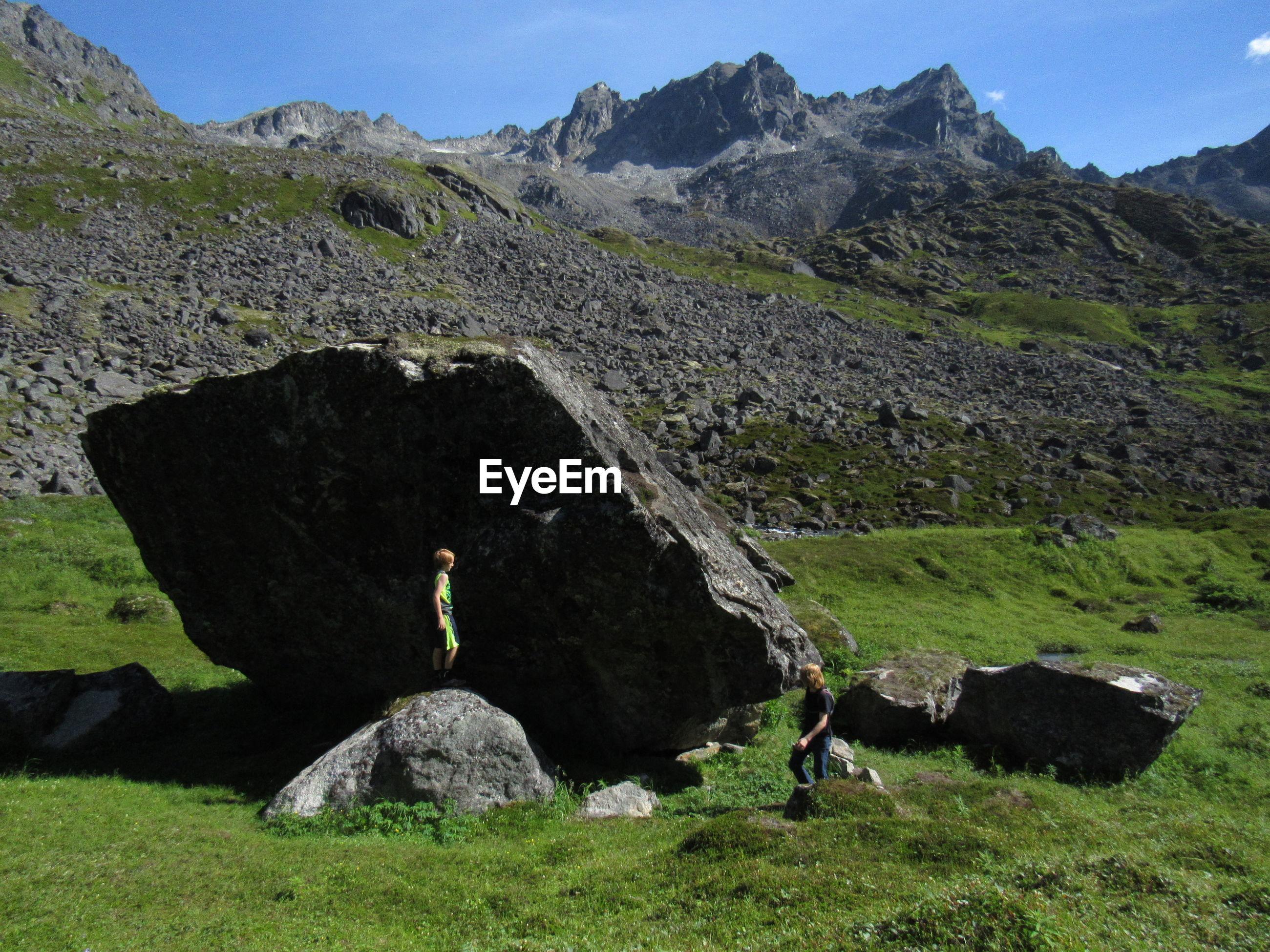 Friends standing by rocks at hatcher pass