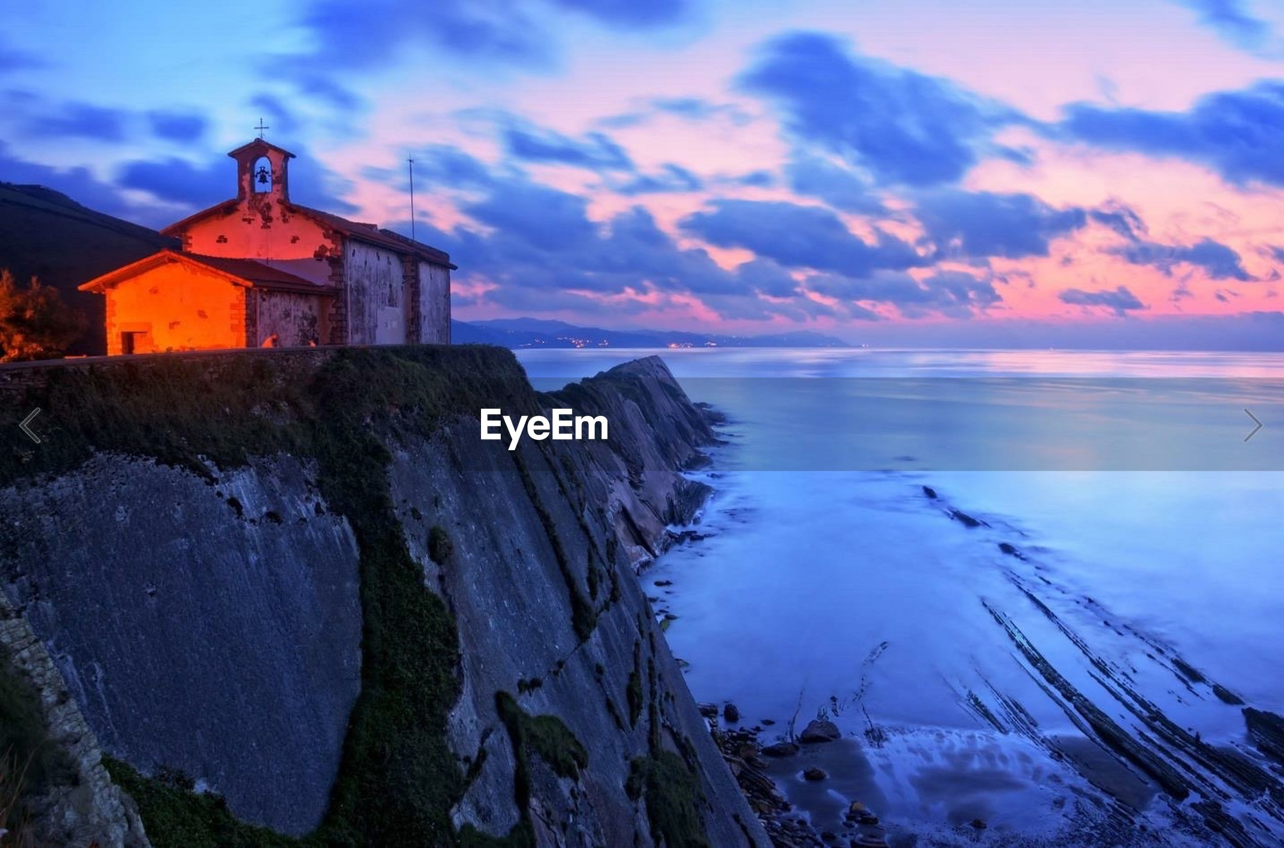 water, sky, sea, built structure, architecture, building exterior, sunset, cloud - sky, scenics, beauty in nature, horizon over water, tranquil scene, tranquility, nature, rock - object, cloud, lighthouse, idyllic, cloudy, rock formation