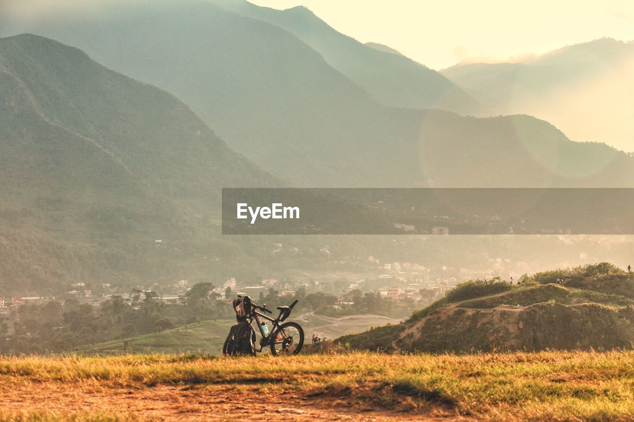 Bike On Landscape Against Sky