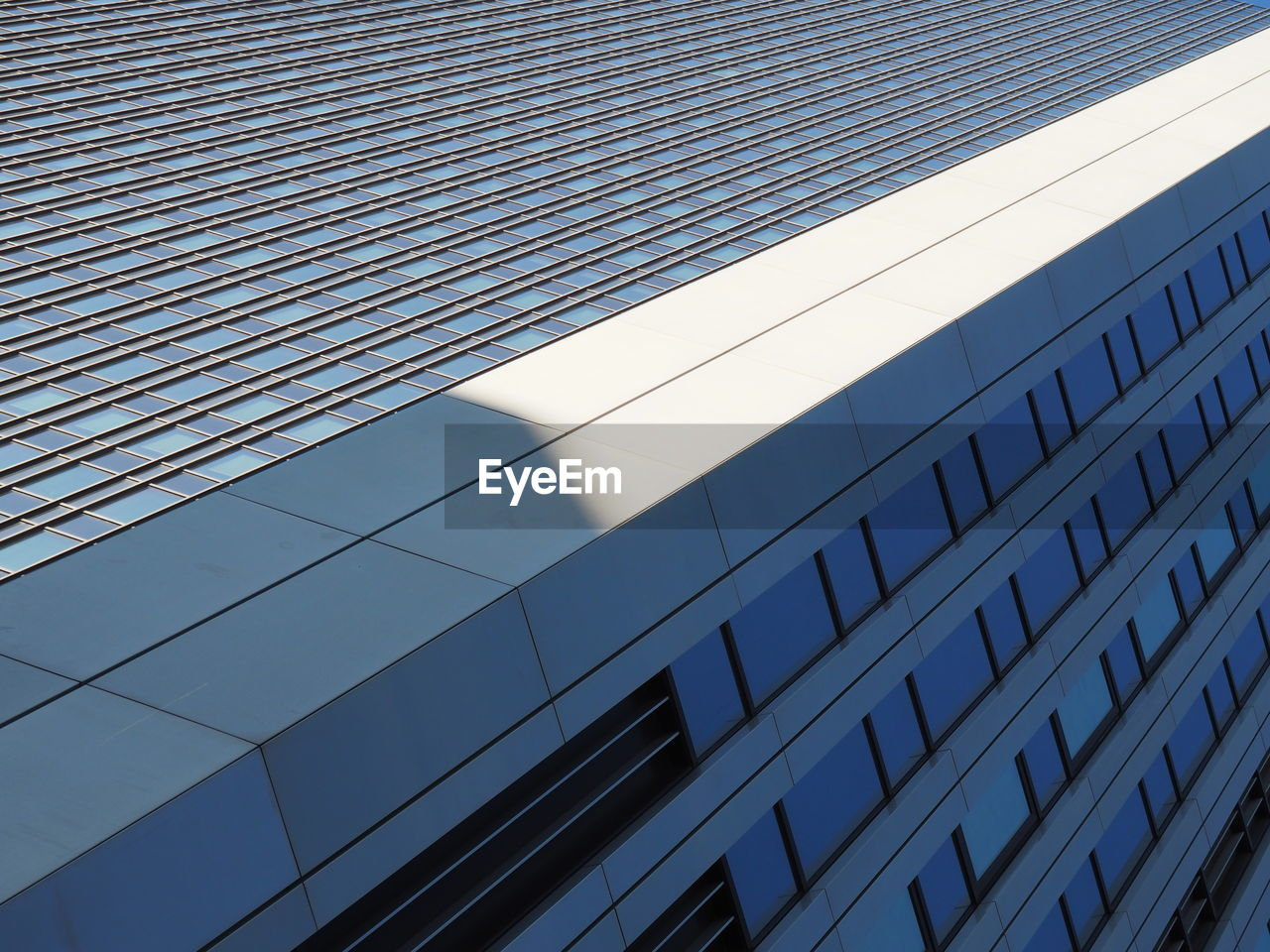 architecture, building exterior, built structure, low angle view, modern, outdoors, no people, day, pattern, corporate business, skyscraper, city