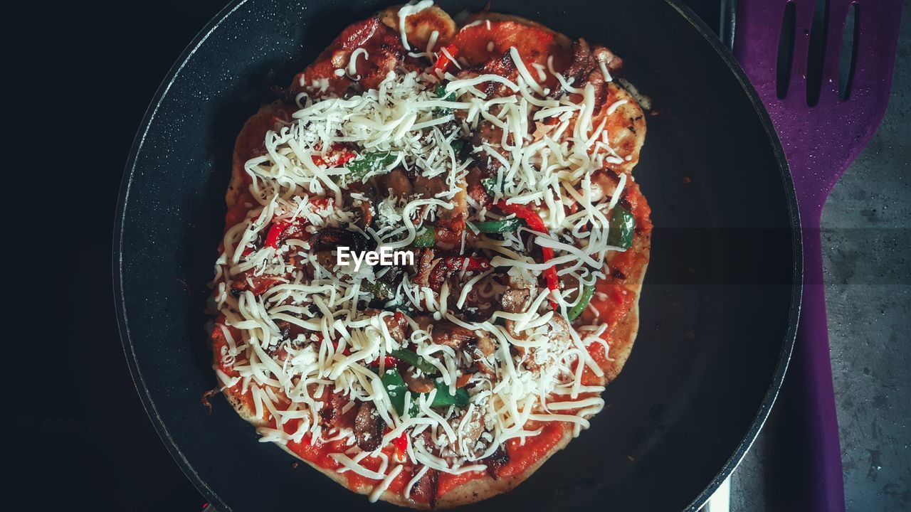 Directly above shot of pizza in cooking pan at home