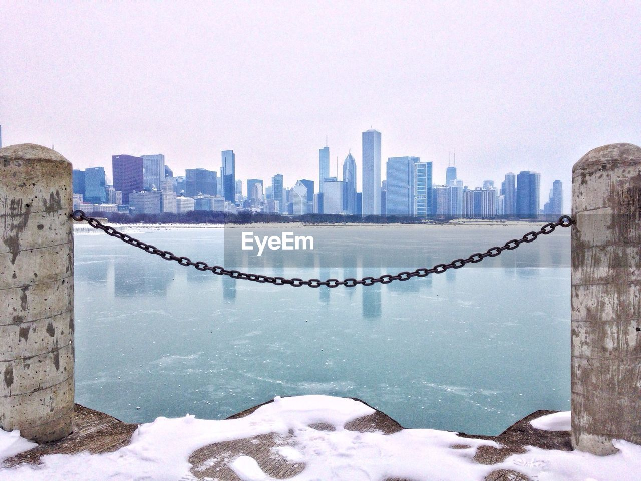 Chain rope fence with sea and skyline in background