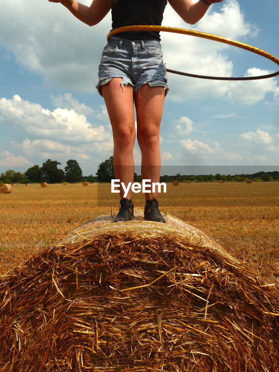 Low Section Of A Woman On Hay Bale