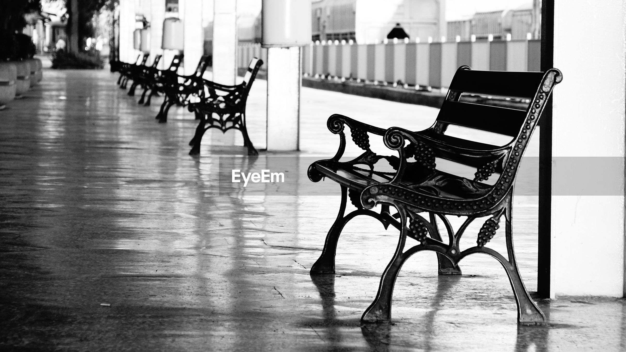 Empty chairs and tables in row