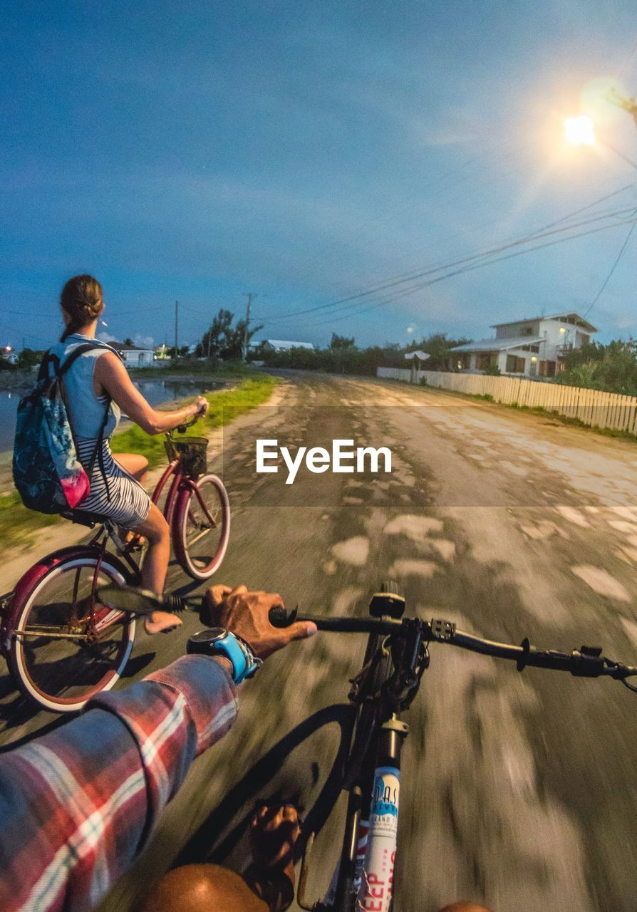 transportation, bicycle, land vehicle, ride, mode of transportation, riding, sport, real people, sky, leisure activity, one person, lifestyles, road, nature, men, cycling, motion, full length, street, outdoors