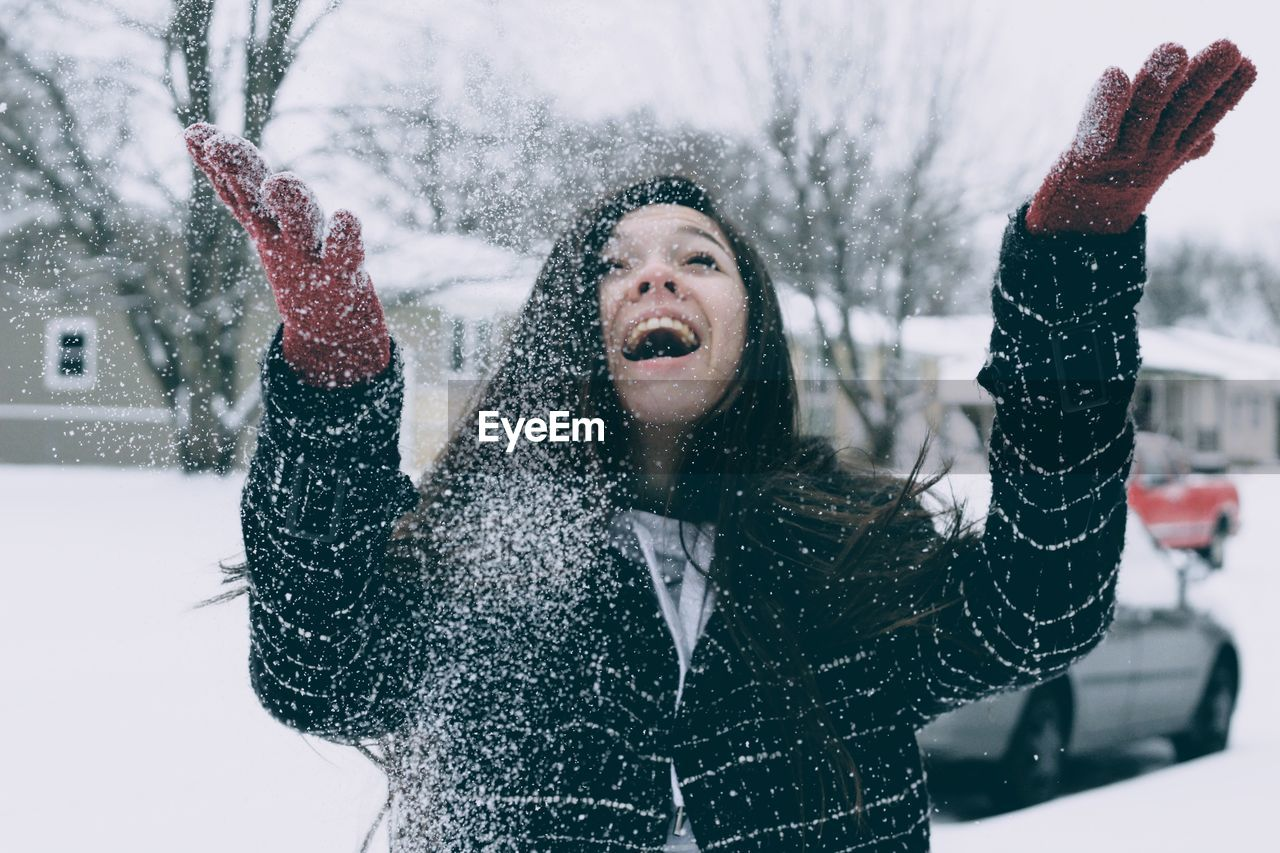 Young woman enjoying in snow