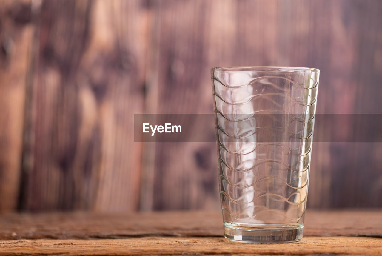 table, household equipment, drinking glass, focus on foreground, drink, food and drink, close-up, glass, refreshment, wood - material, no people, glass - material, indoors, still life, freshness, transparent, day, drinking water, nature, purity