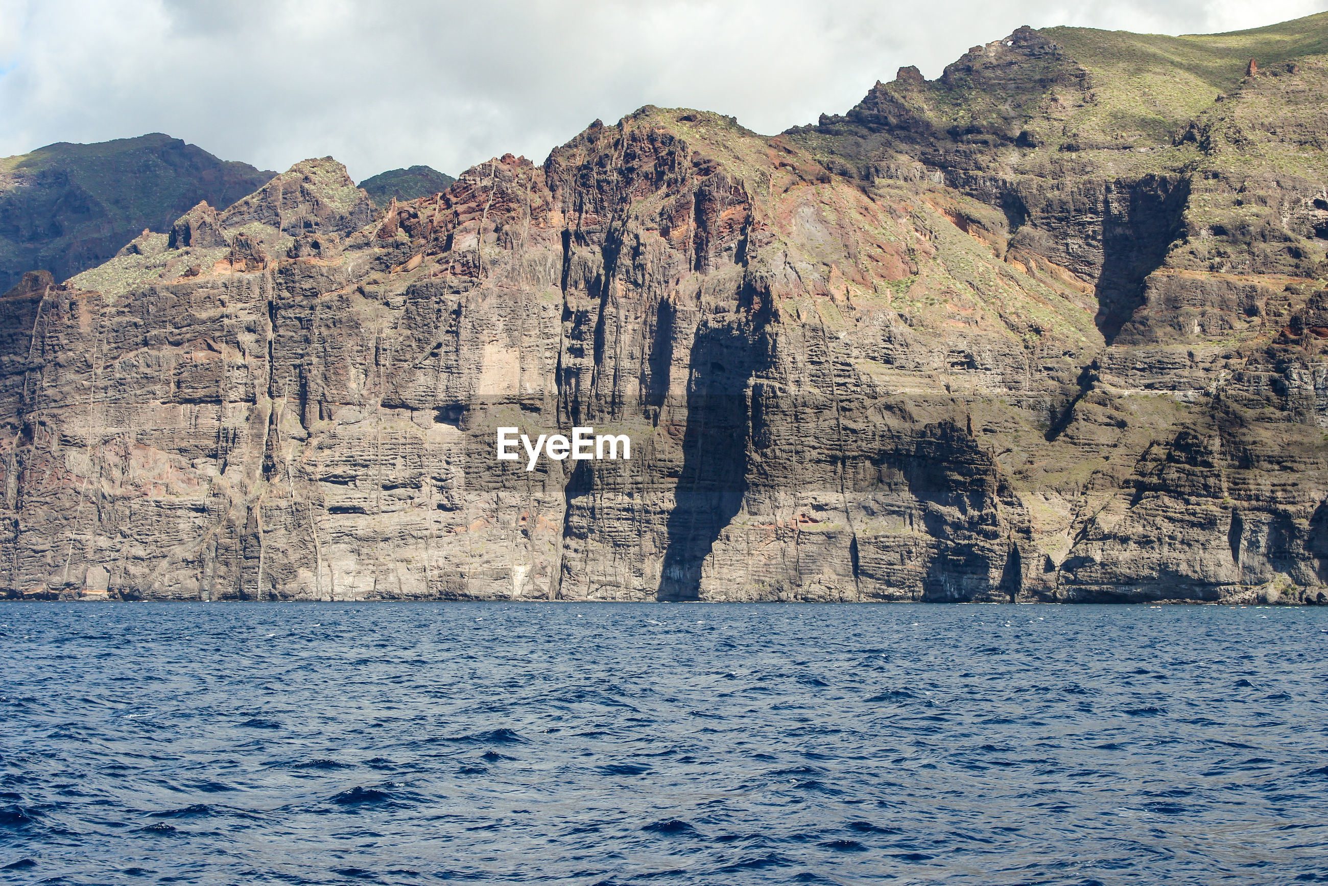 View on the steep coast of los gigantes on canary island tenerife with rocks in different colors